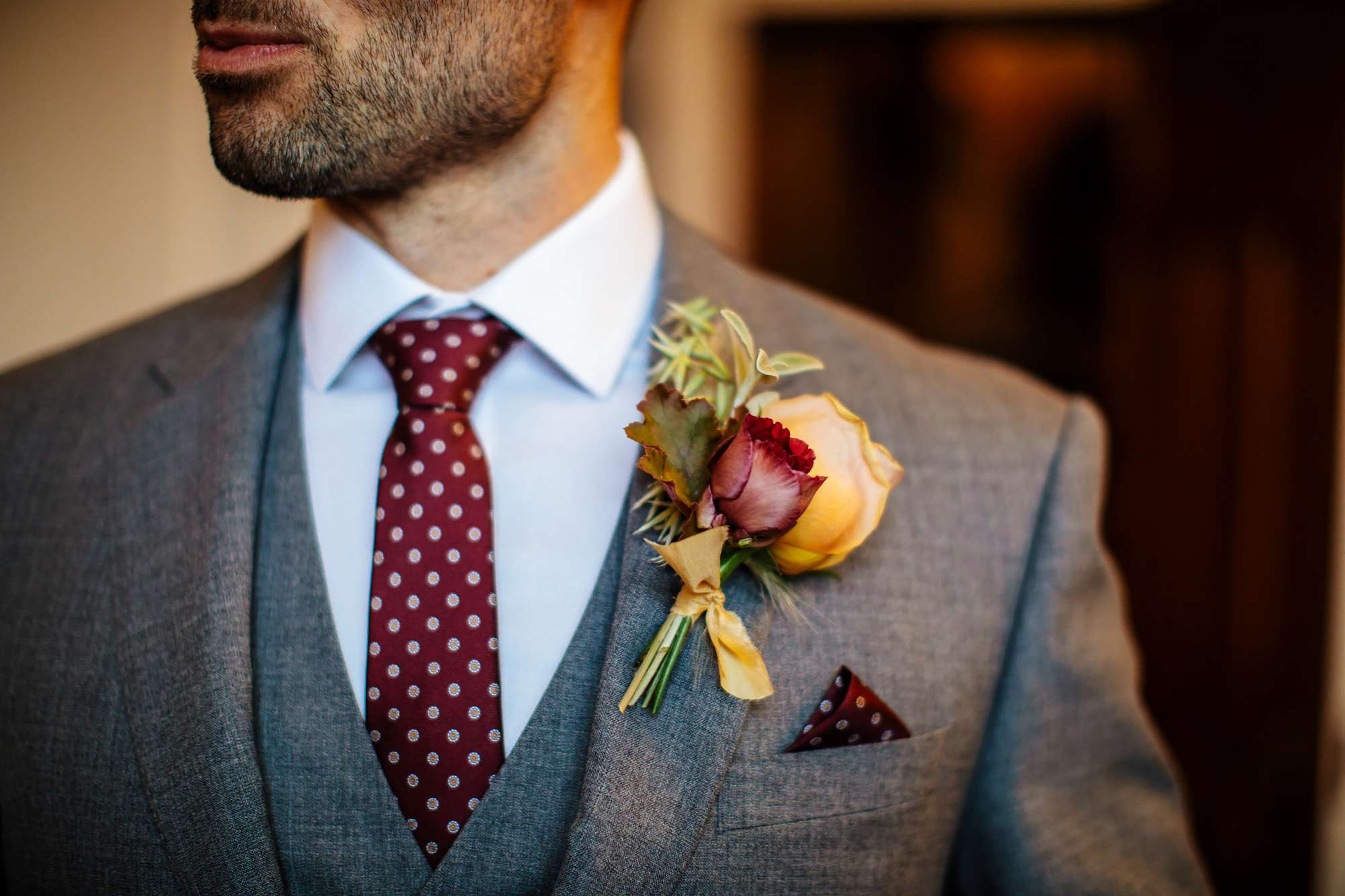 Grooms suit details on his wedding day
