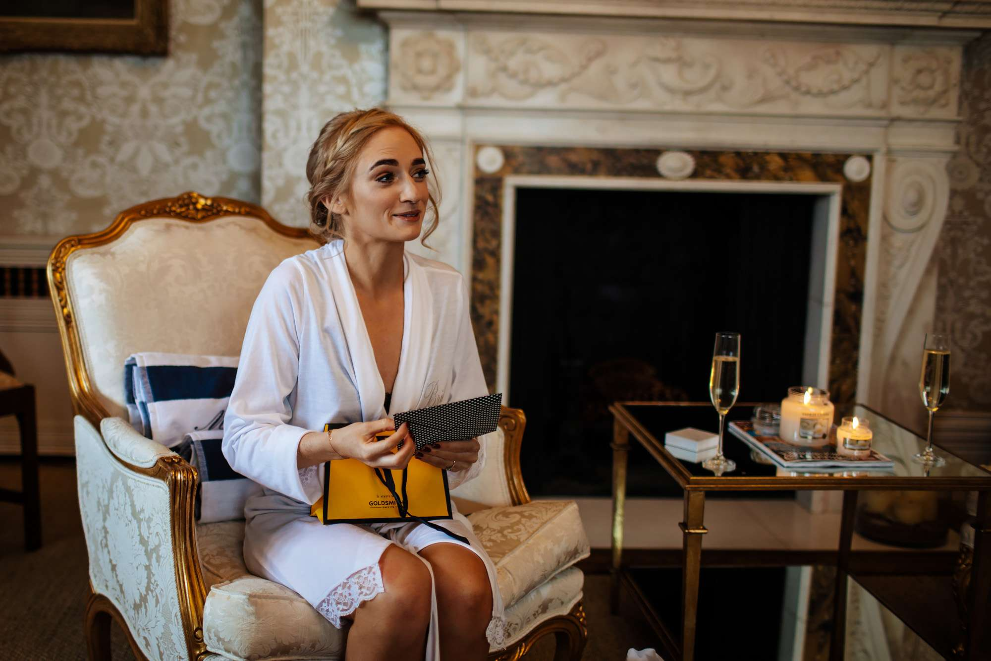 Bride opens gifts before her wedding at Cowdray House