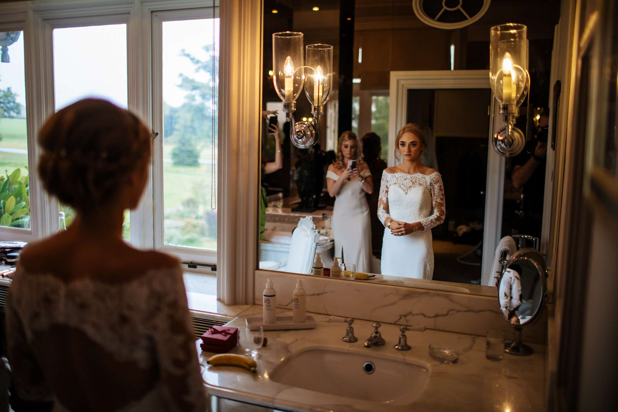 Bride looking in the mirror before her wedding ceremony