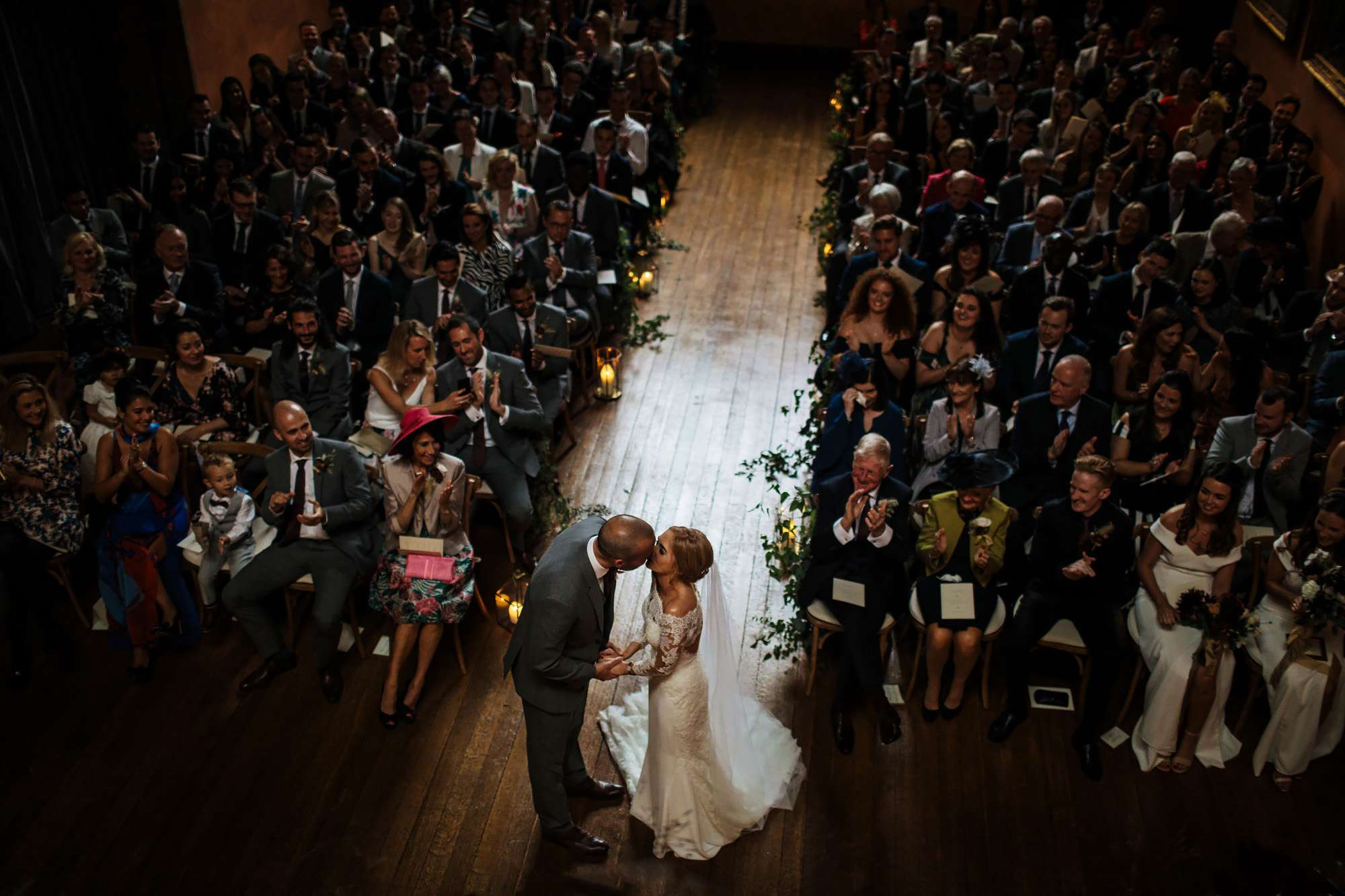 Bride and groom kiss at their wedding at Cowdray House