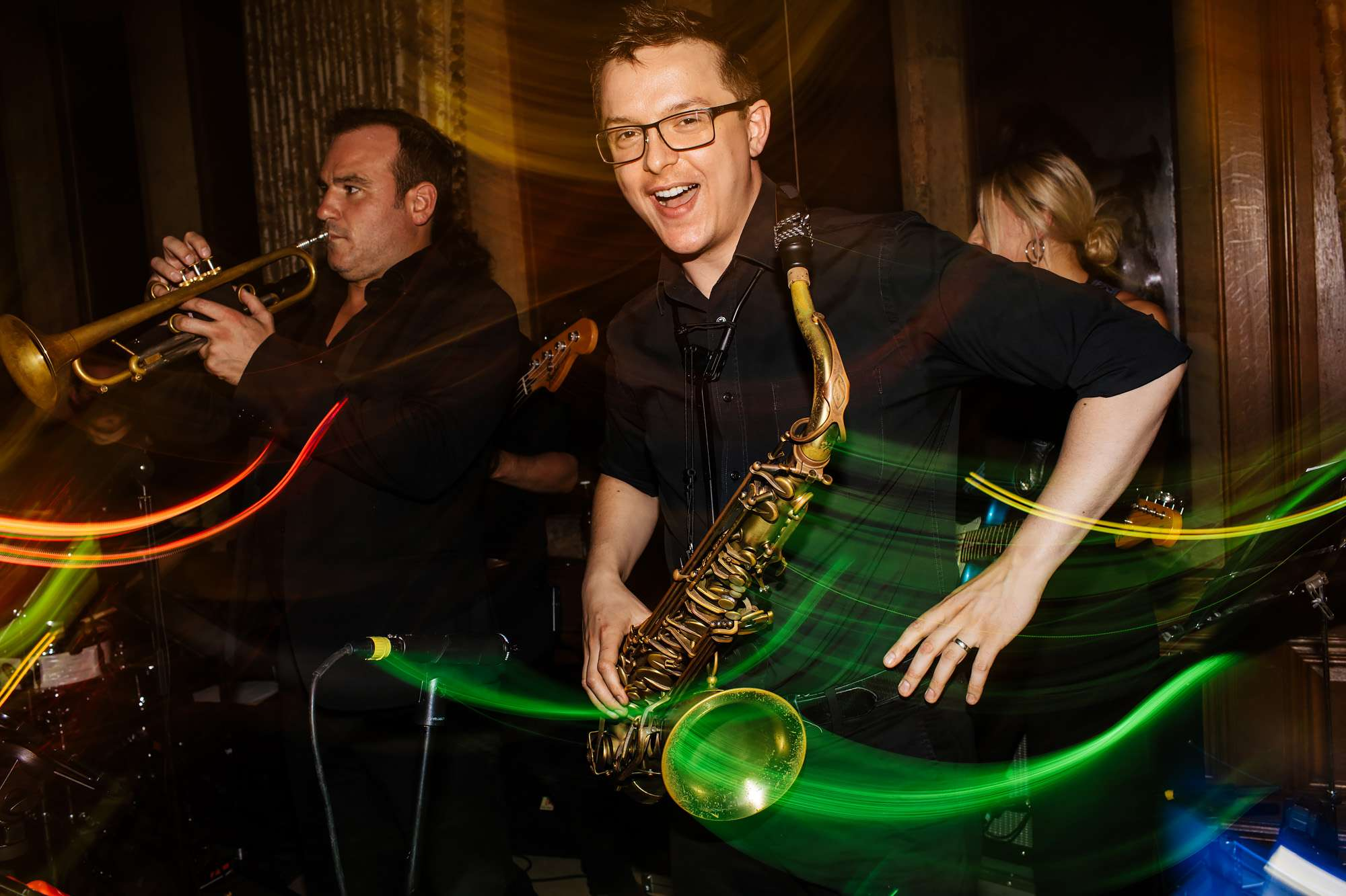 Saxophonist dancing at a wedding