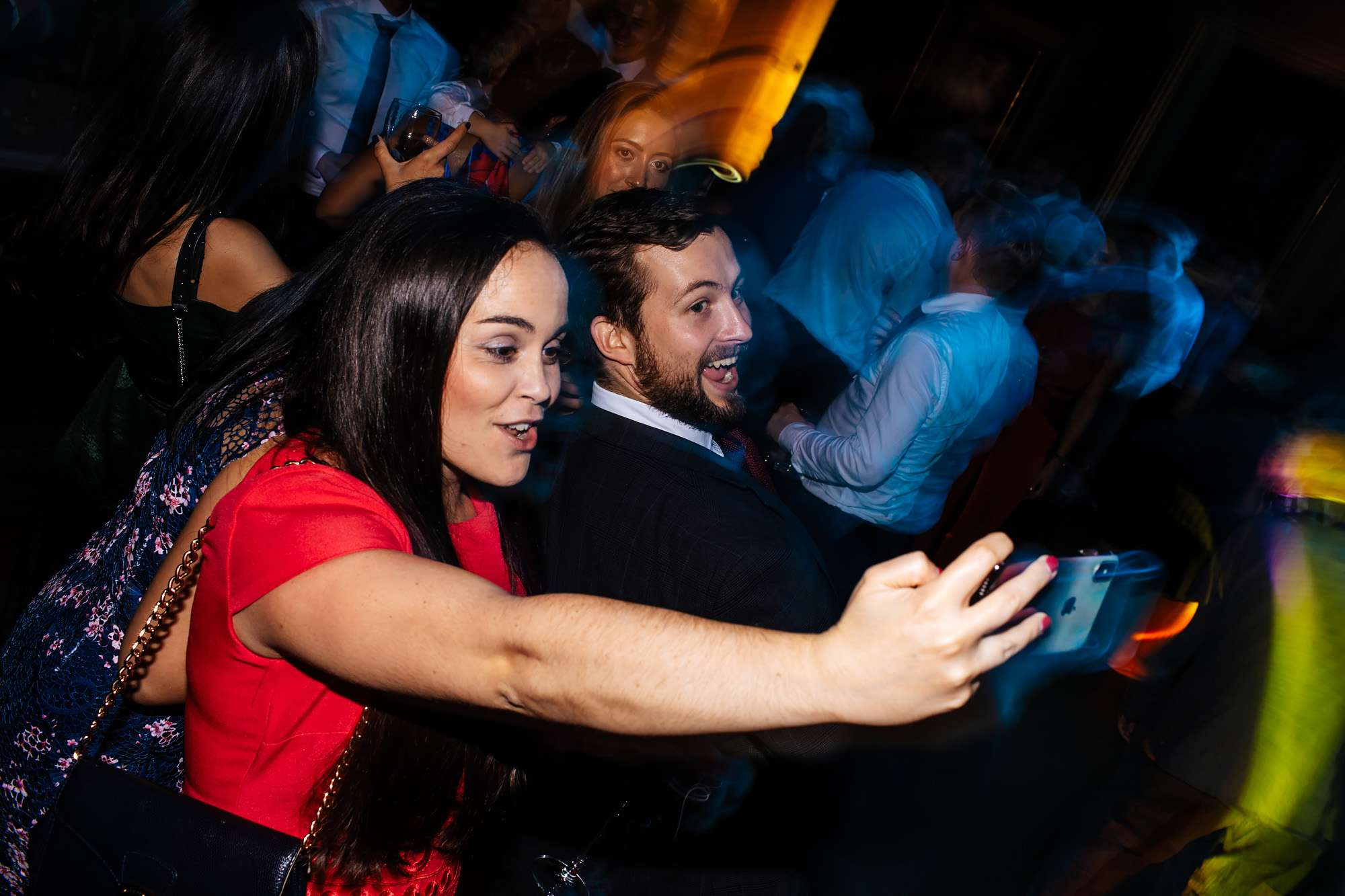 Wedding guests taking selfies and laughing
