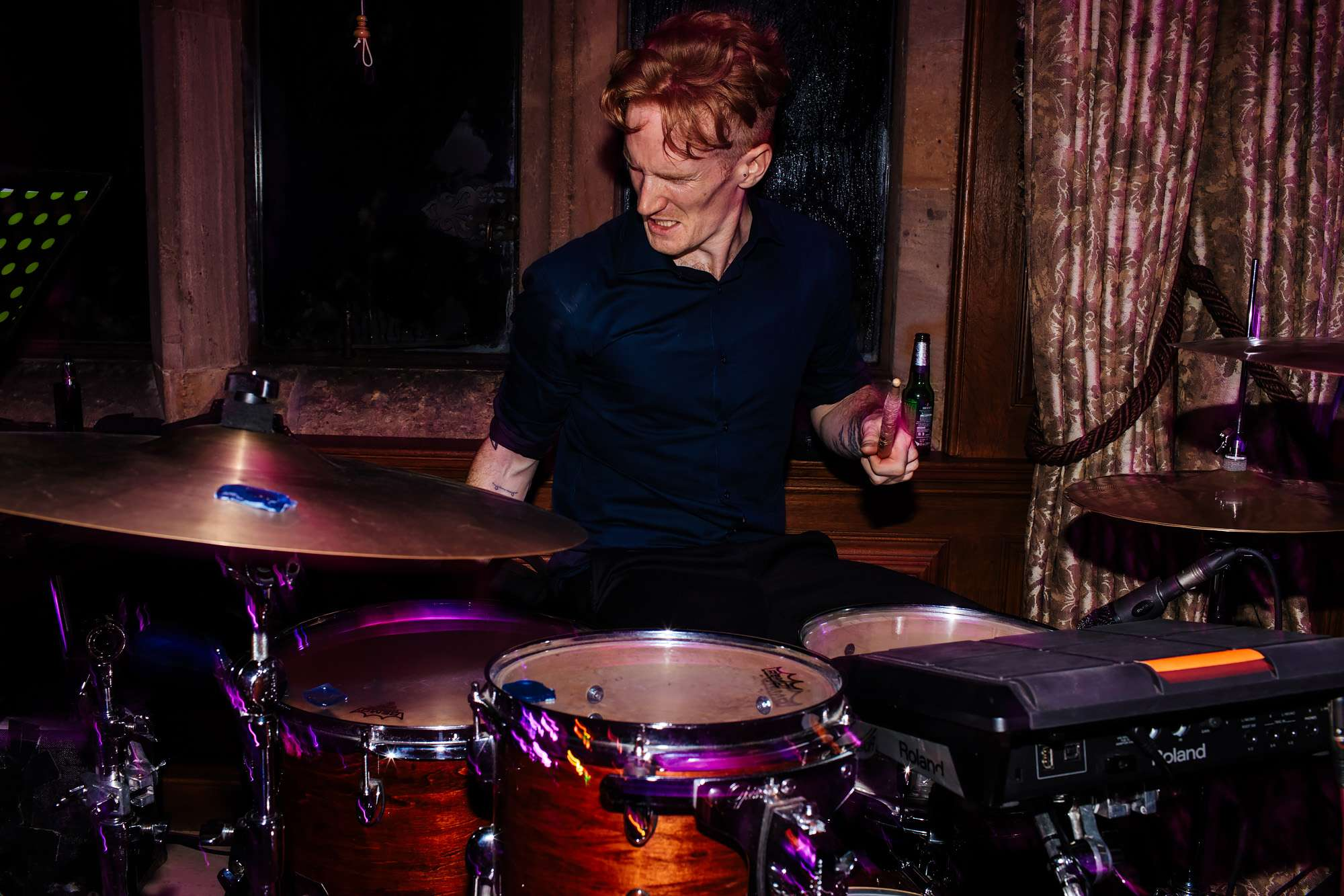 Drummer in the band at a wedding at Cowdray House