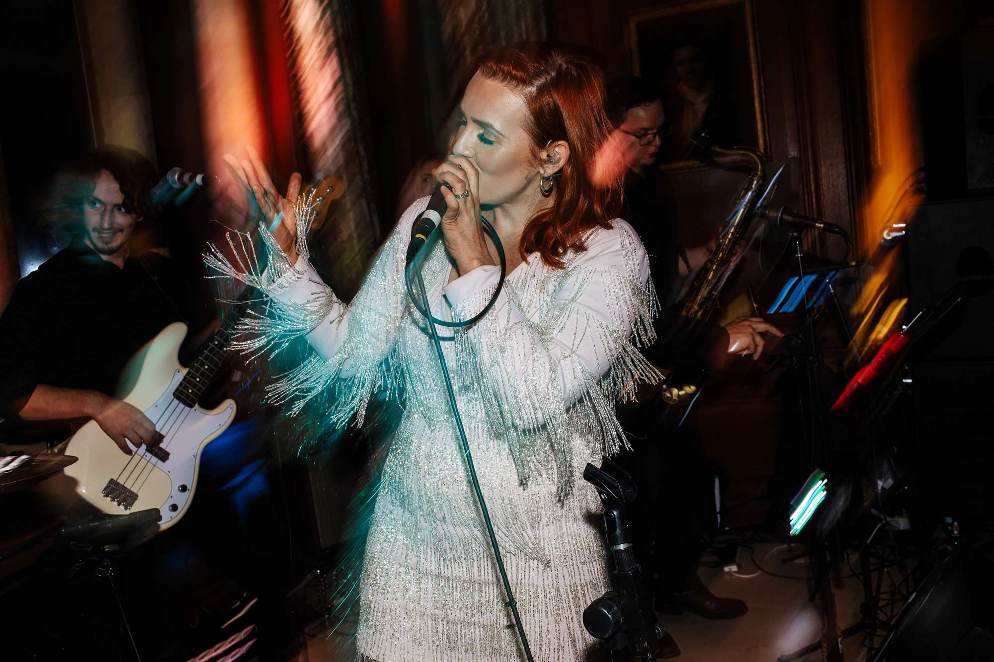 Singer performing in the band at a wedding