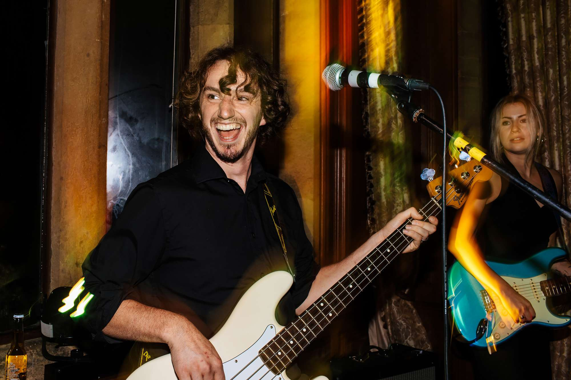 Bass player laughing at a wedding