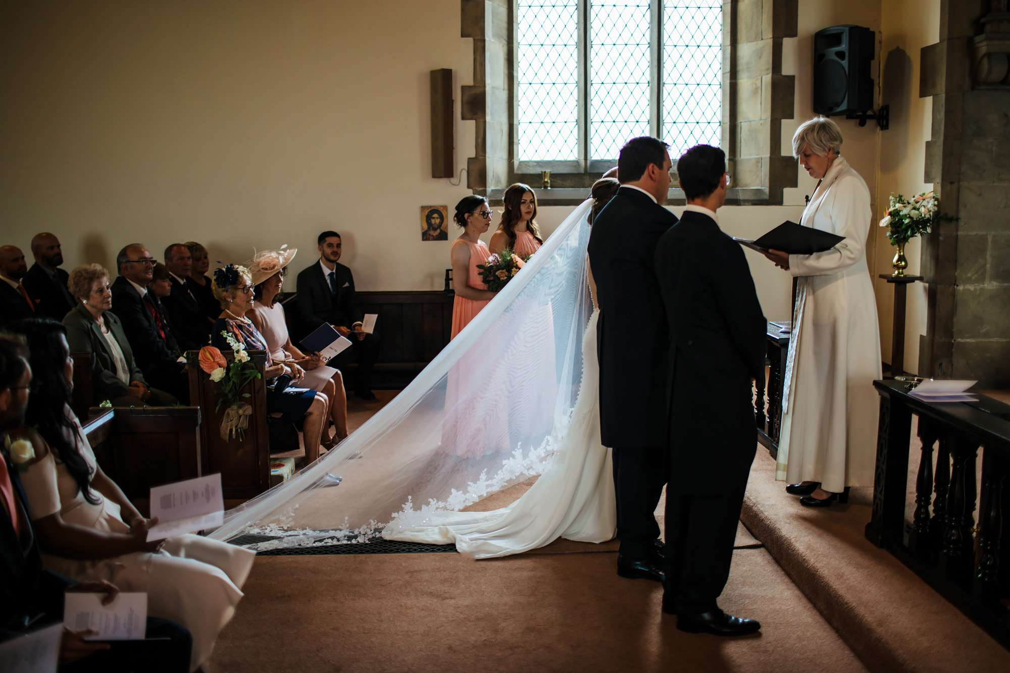Bride and groom standing at the alter during their wedding