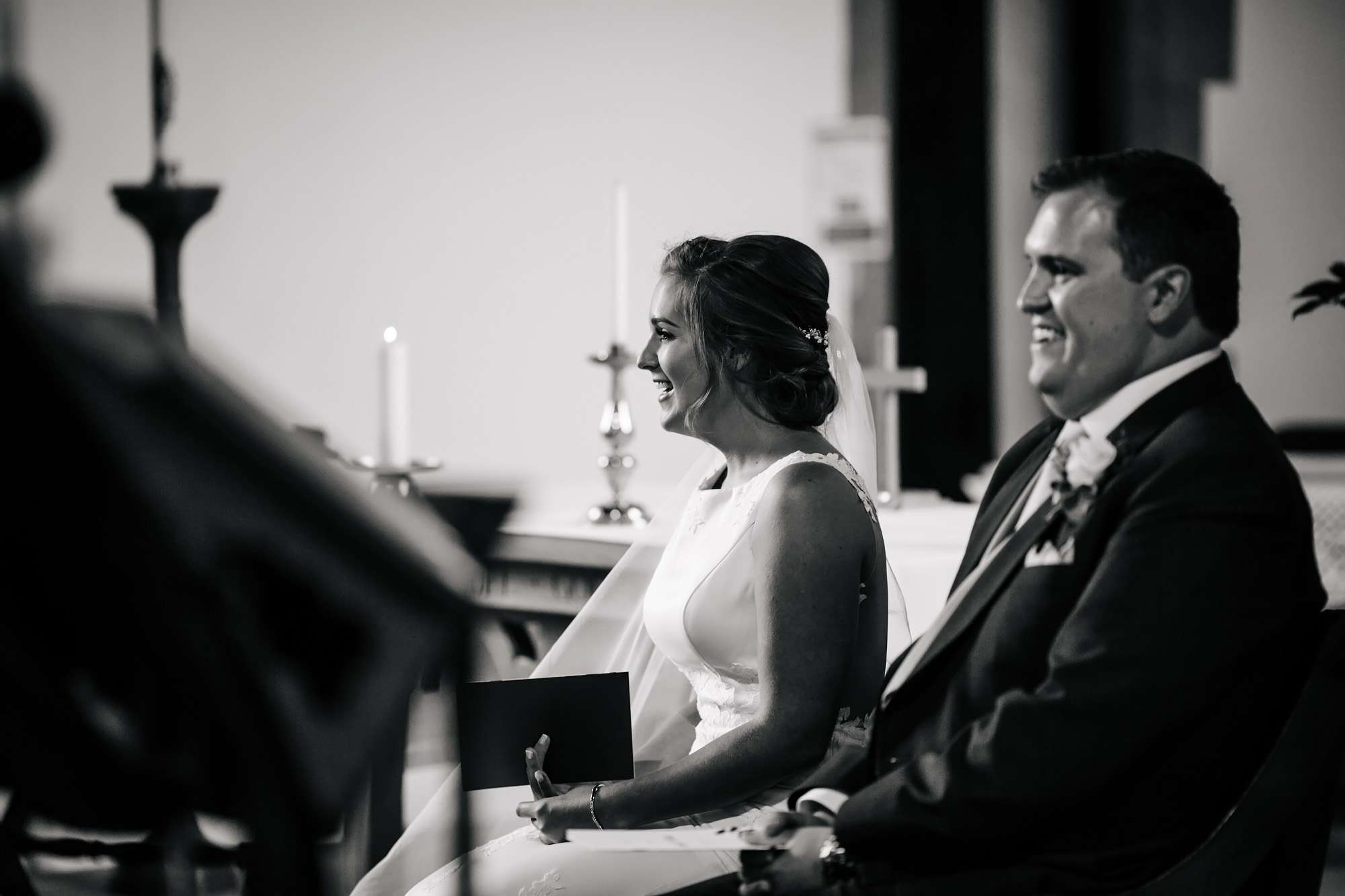 Bride and groom laughing at their Huddersfield wedding