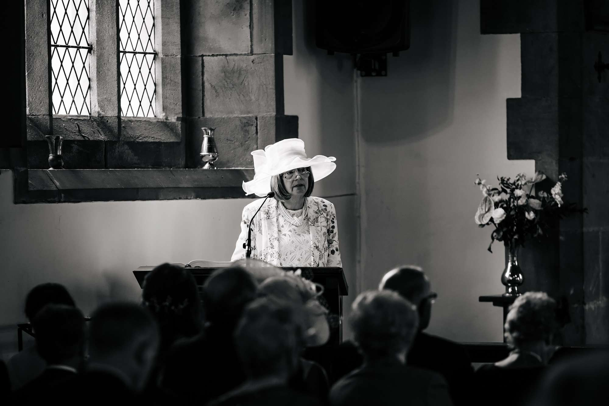 Bride's mother performs a reading in the church wedding