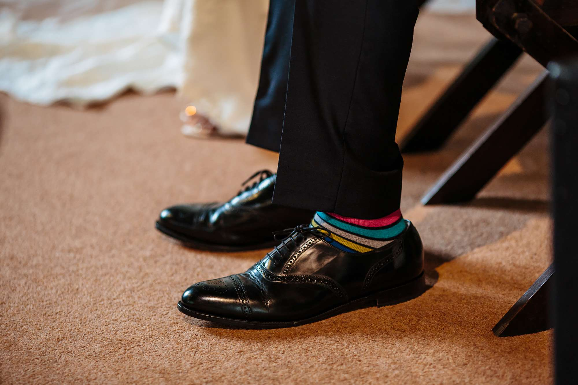 Groom's colourful socks at a wedding in Yorkshire