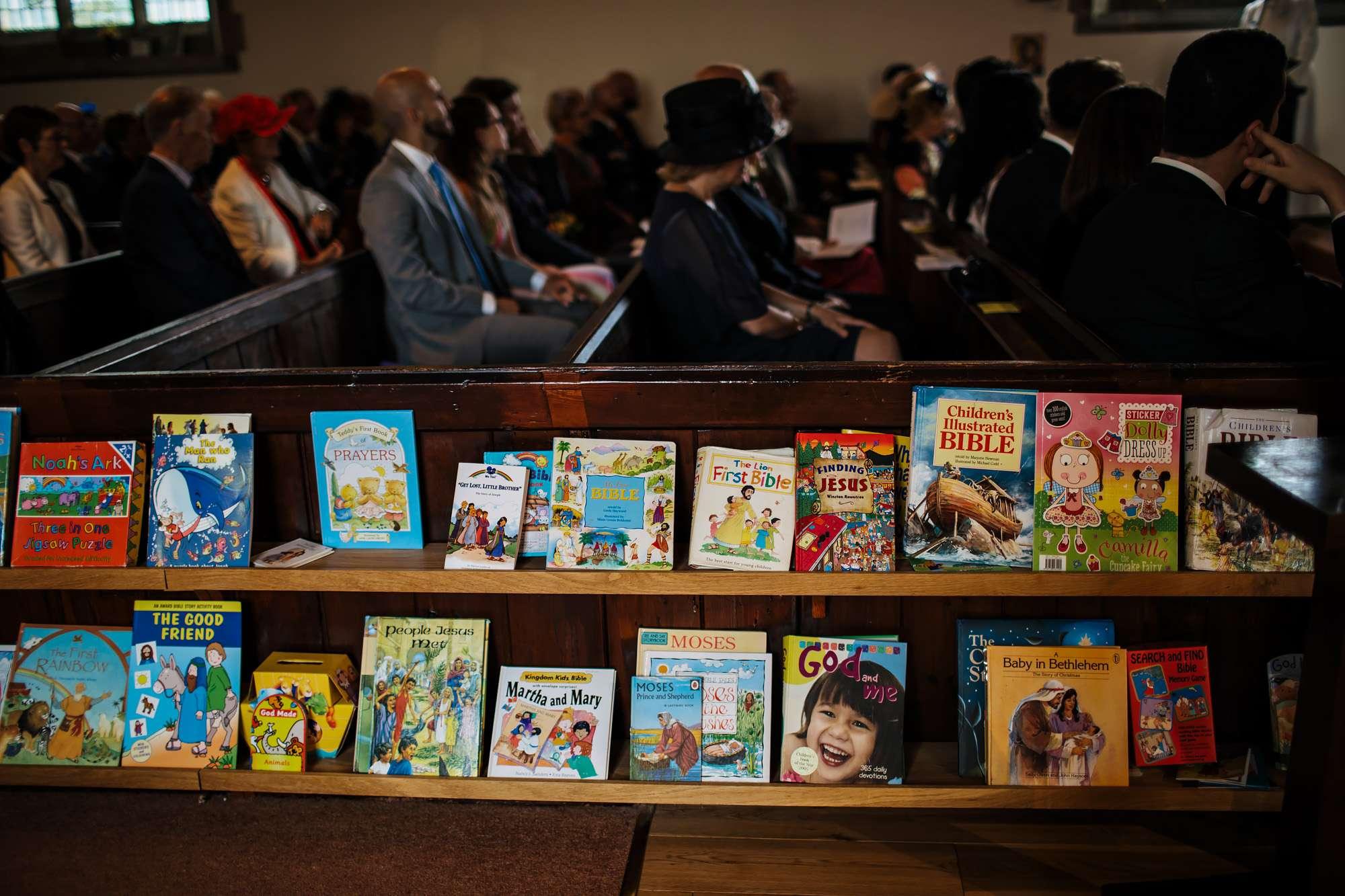 Colourful bookshelf at a Huddersfield church wedding