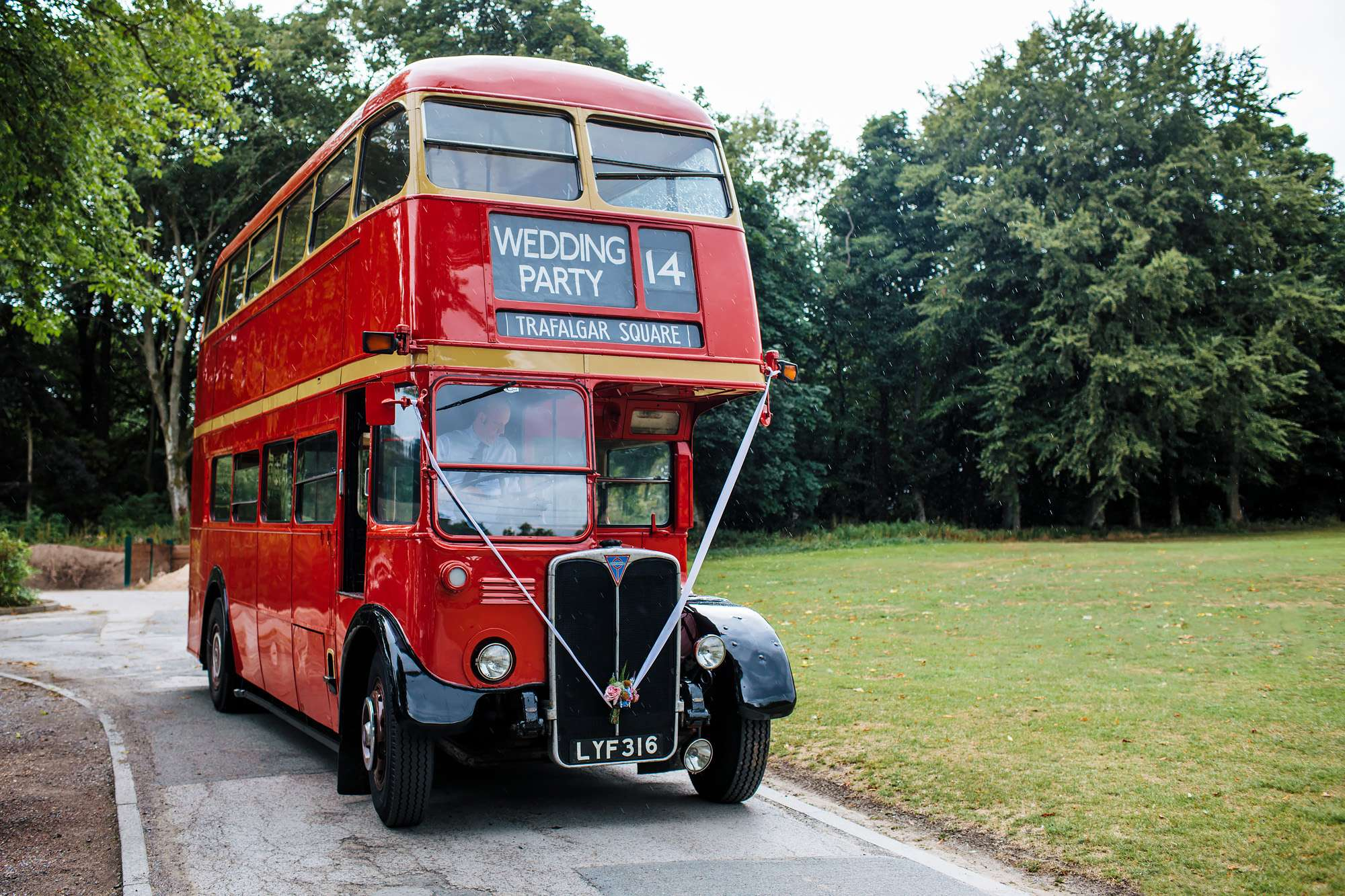 Vintage red double decker bus for a wedding party