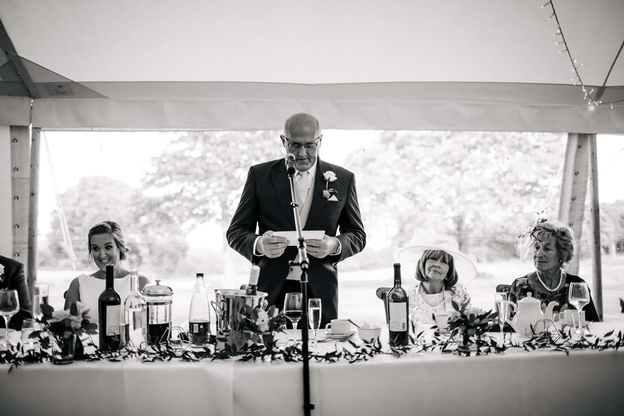Bride's dad doing mid-speech at a wedding