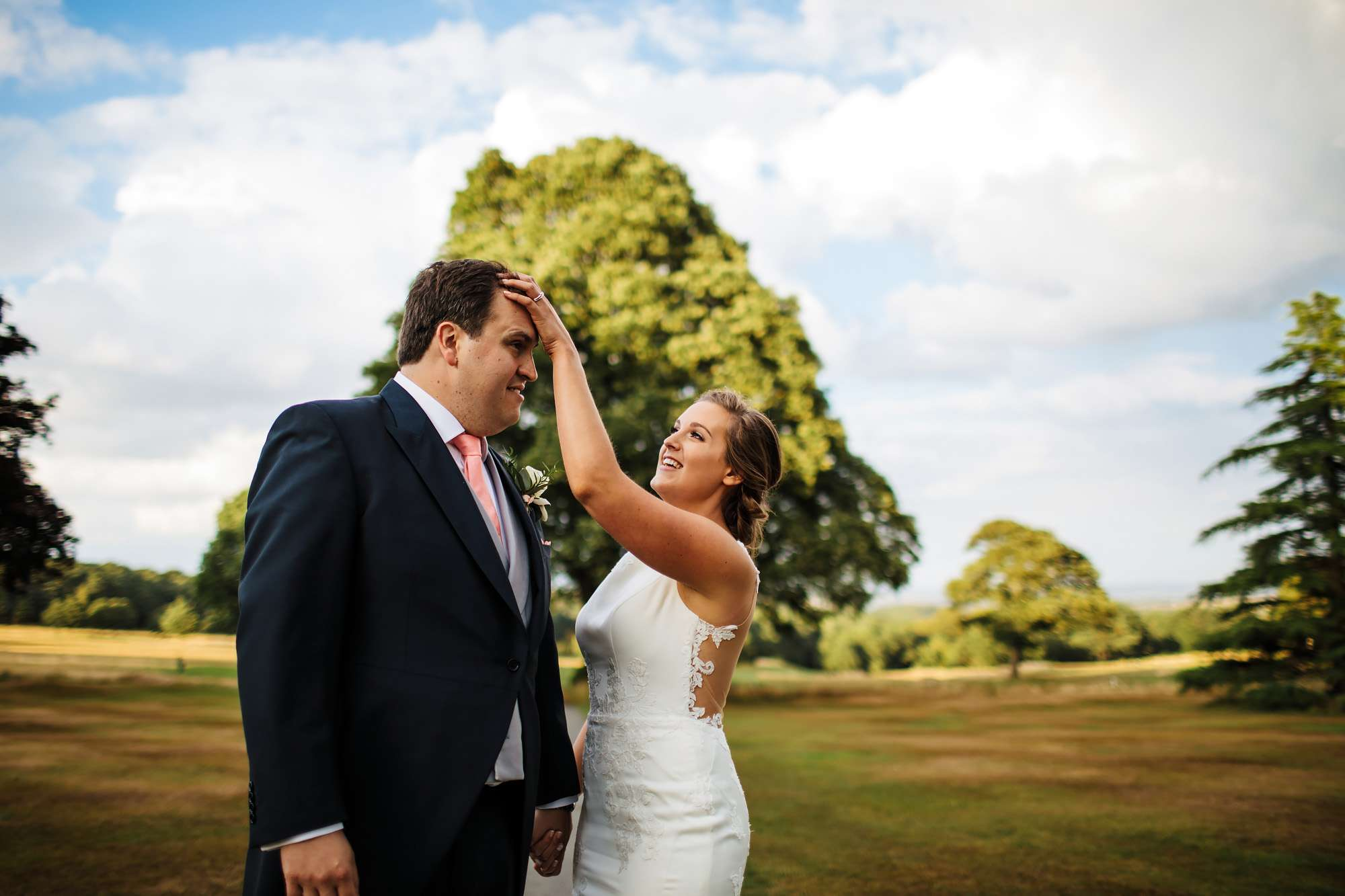 Bride adjusting the groom's hair at a Yorkshire wedding