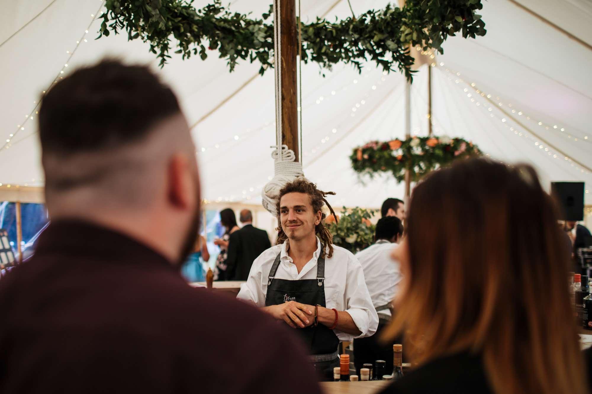Barman working at a wedding at Fixby Hall