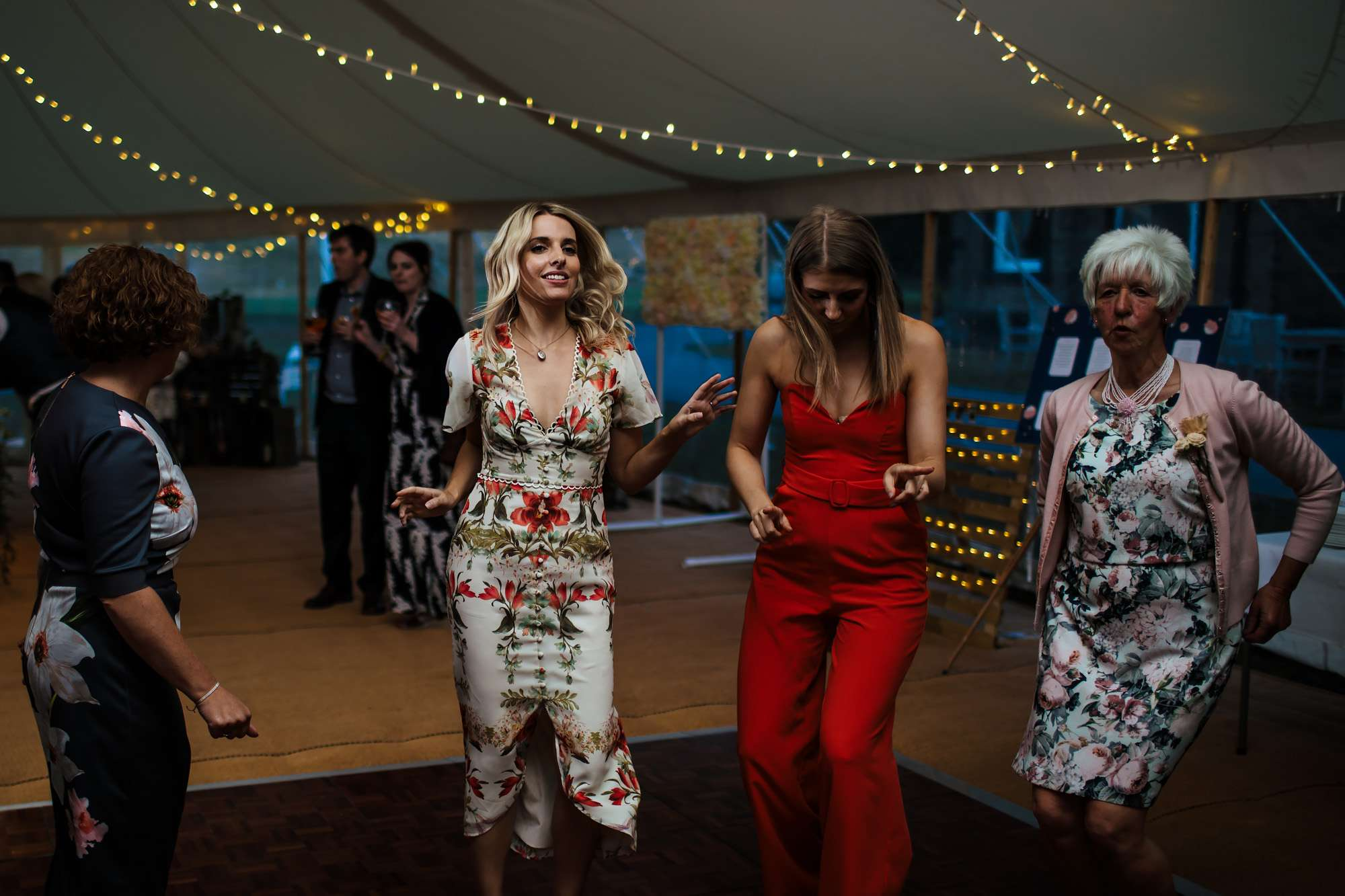 Wedding guests dancing in a marquee at Fixby Hall