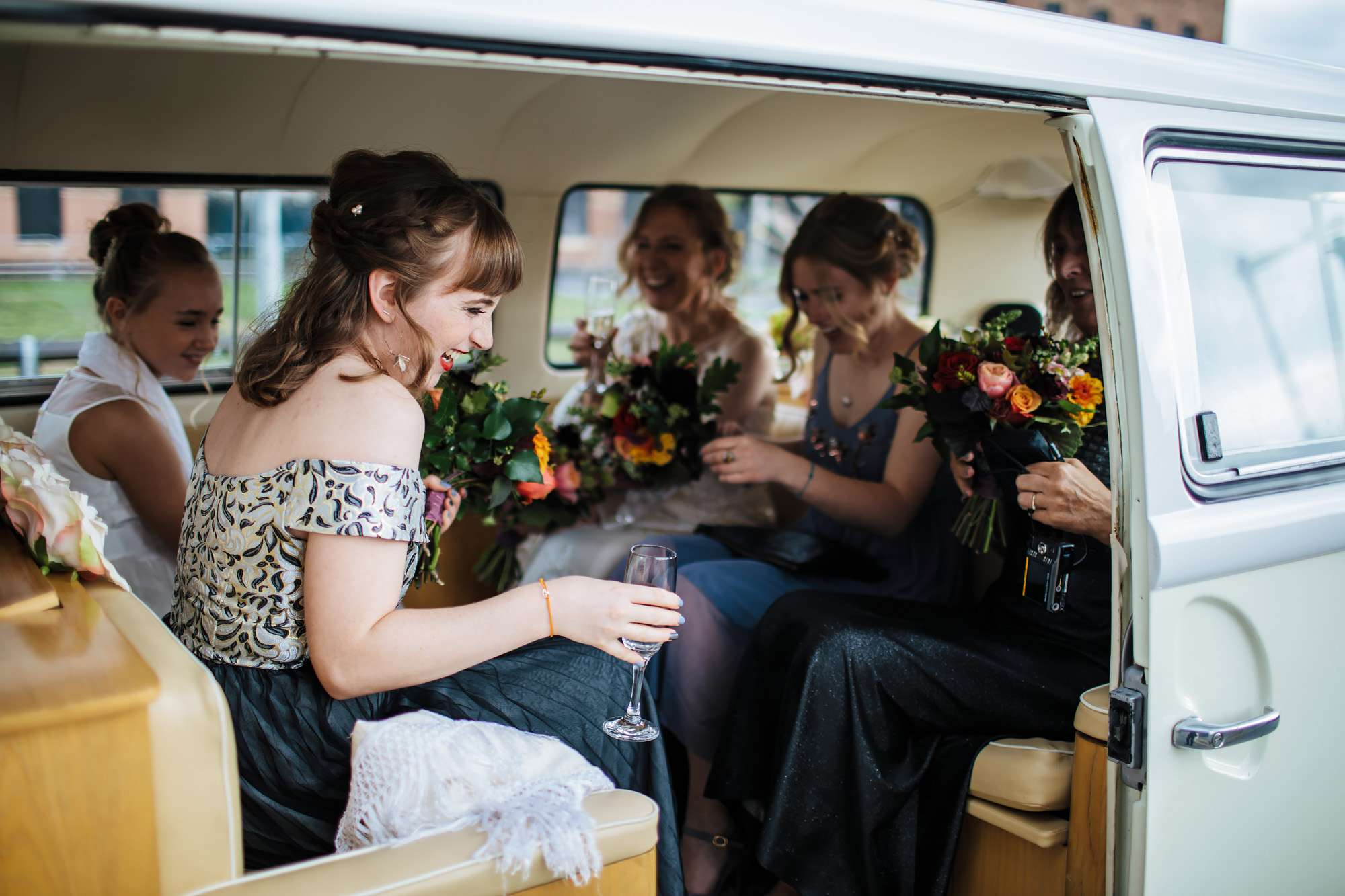 Bride and bridesmaids in a VW campervan