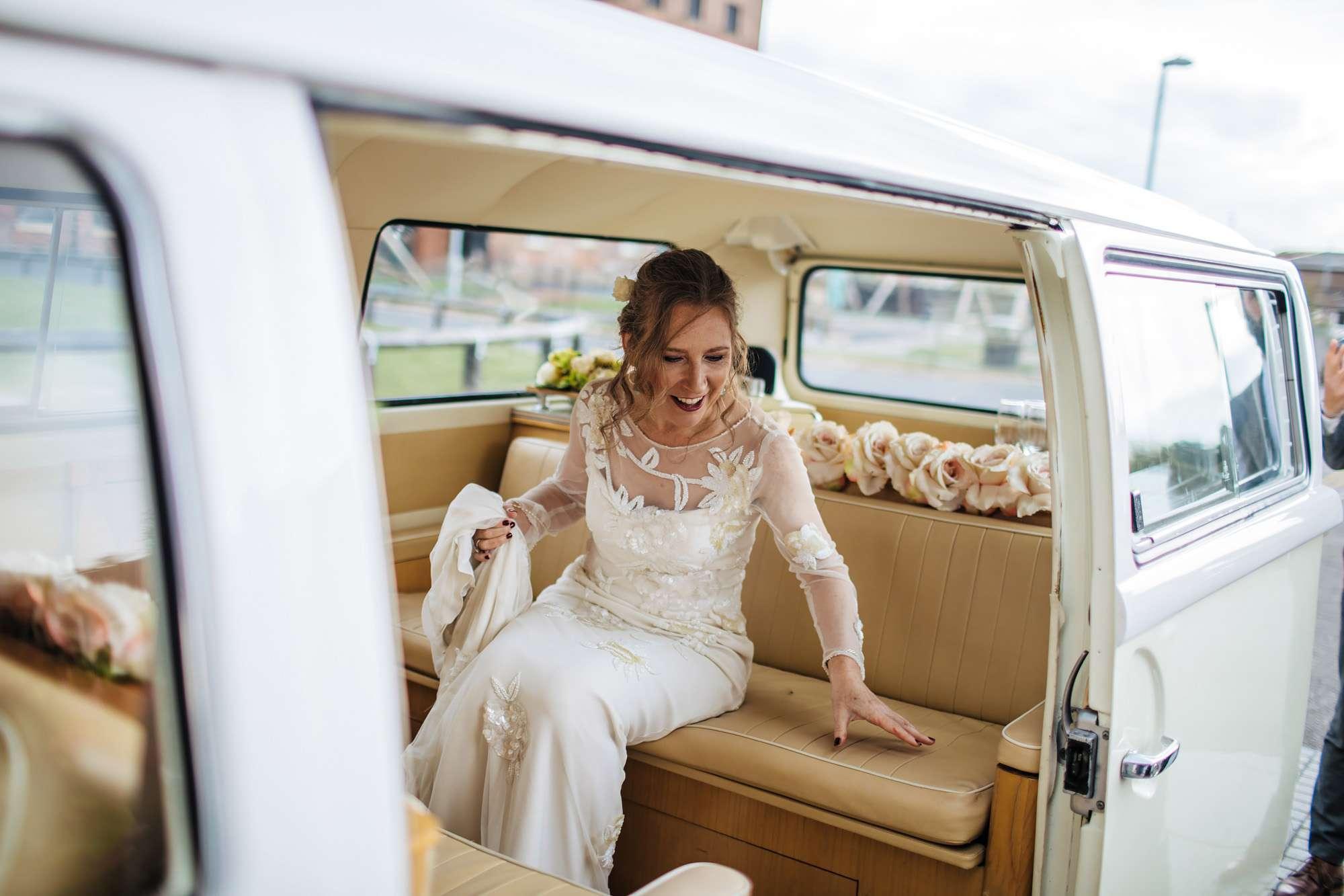 Bride arrives at her wedding in a VW campervan