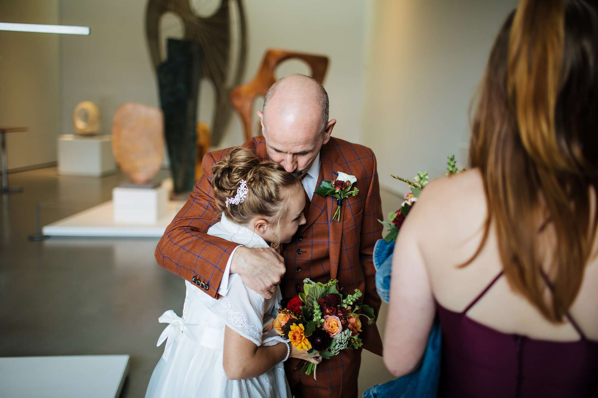 Groom hugs his daughter on his wedding day in Yorkshire