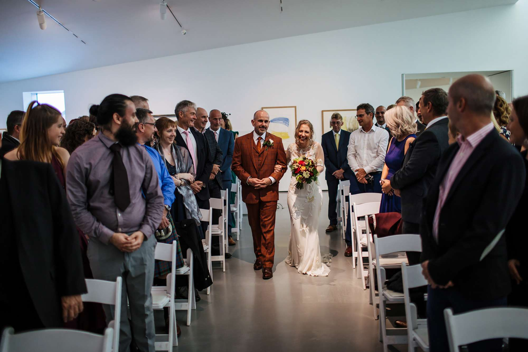 Bride and groom walk down the aisle at Hepworth Art Gallery