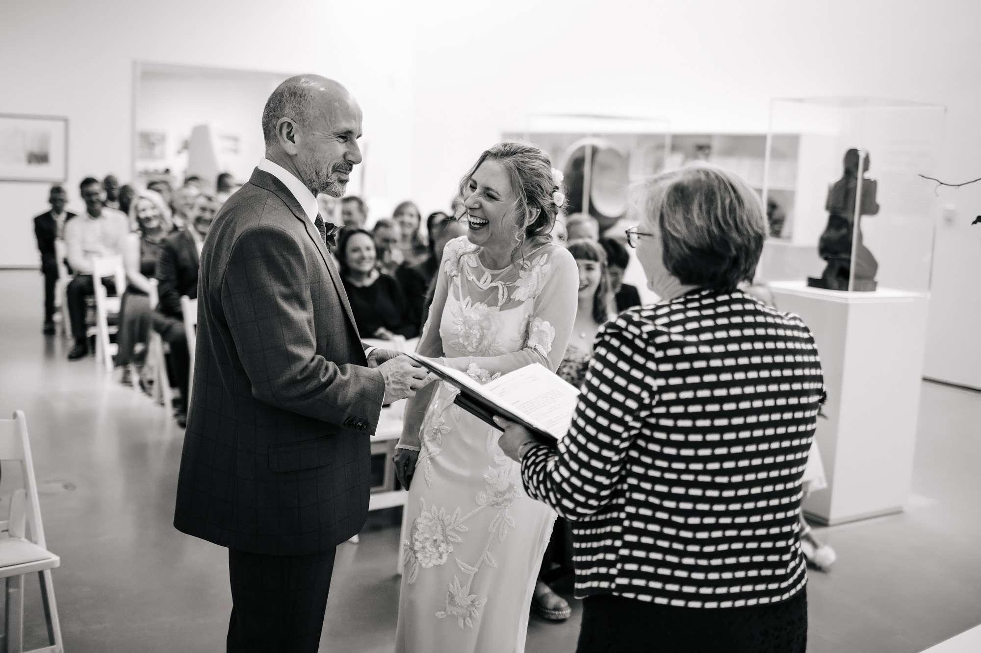 Bride and groom exchange rings at a Hepworth Art Gallery wedding