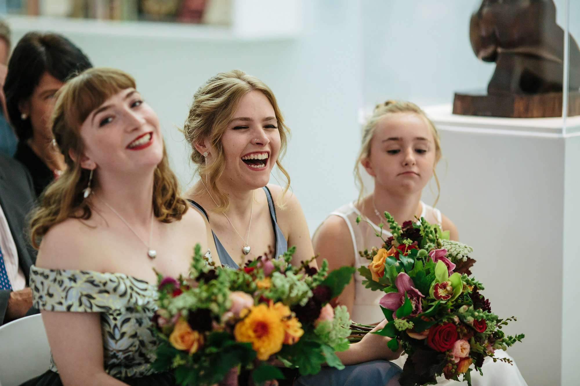 Wedding guests laughing at Hepworth Art Gallery