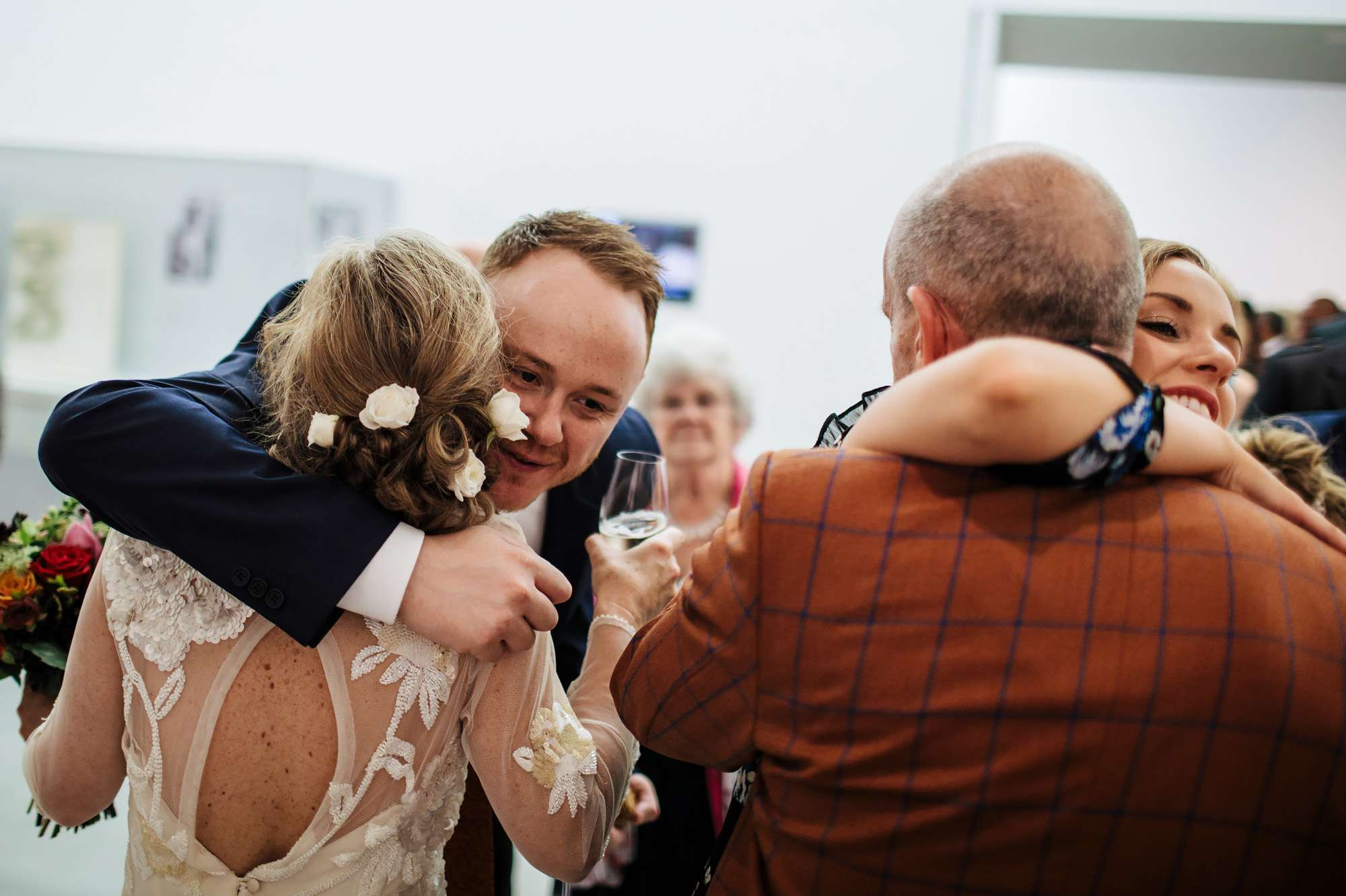 Bride hugs the wedding guests after the ceremony