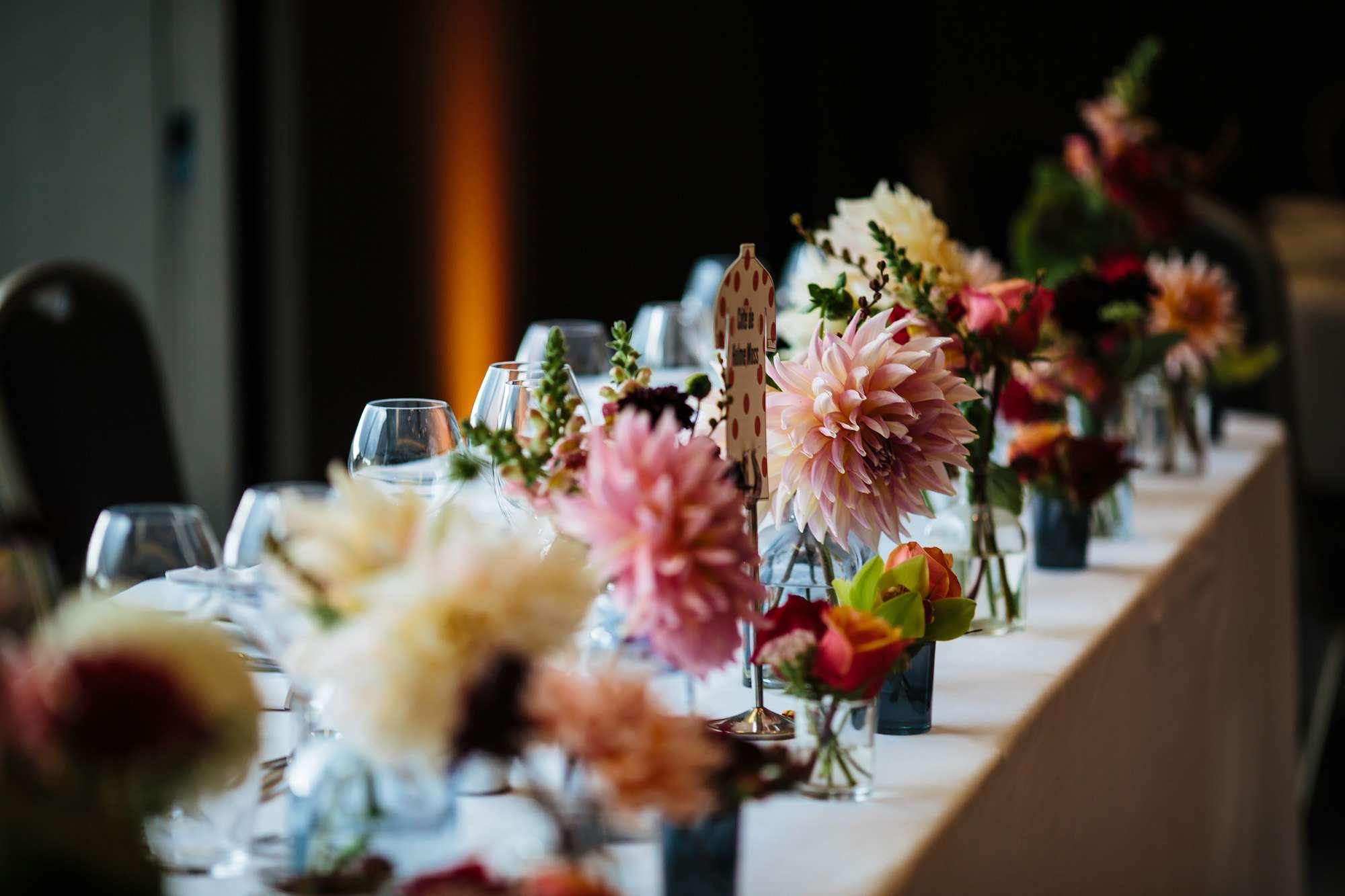 Table flowers at Hepworth Art Gallery wedding