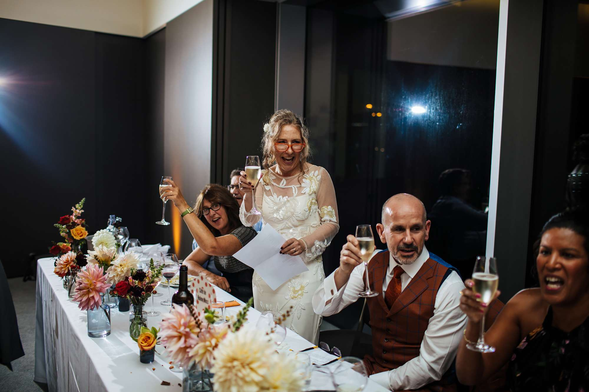 Bride makes a toast at her wedding in Wakefield