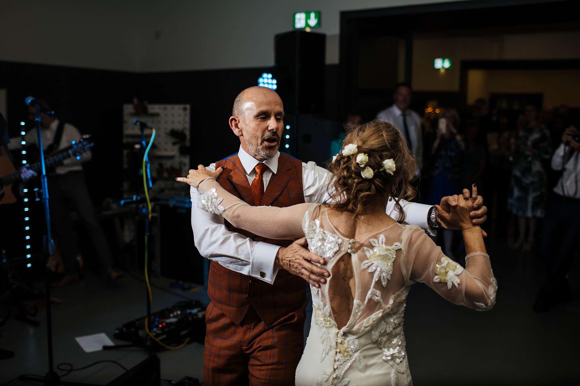 Bride and groom dancing at their wedding in Wakefield