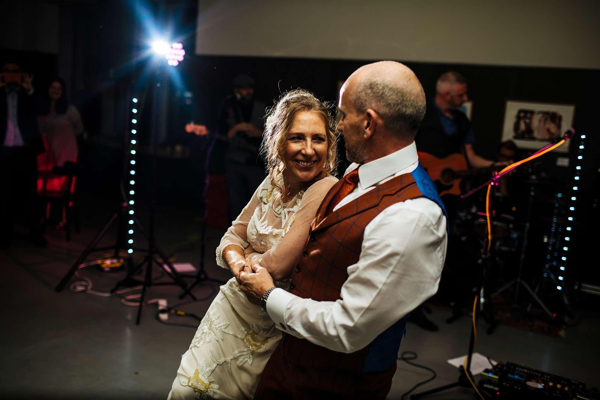 Bride and groom celebrate their wedding at Hepworth Art Gallery