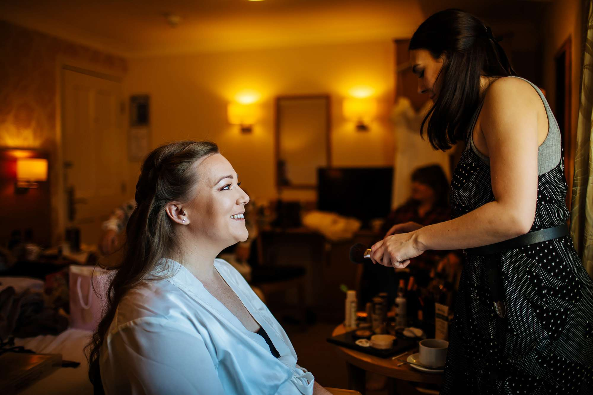 Bride has her make up applied