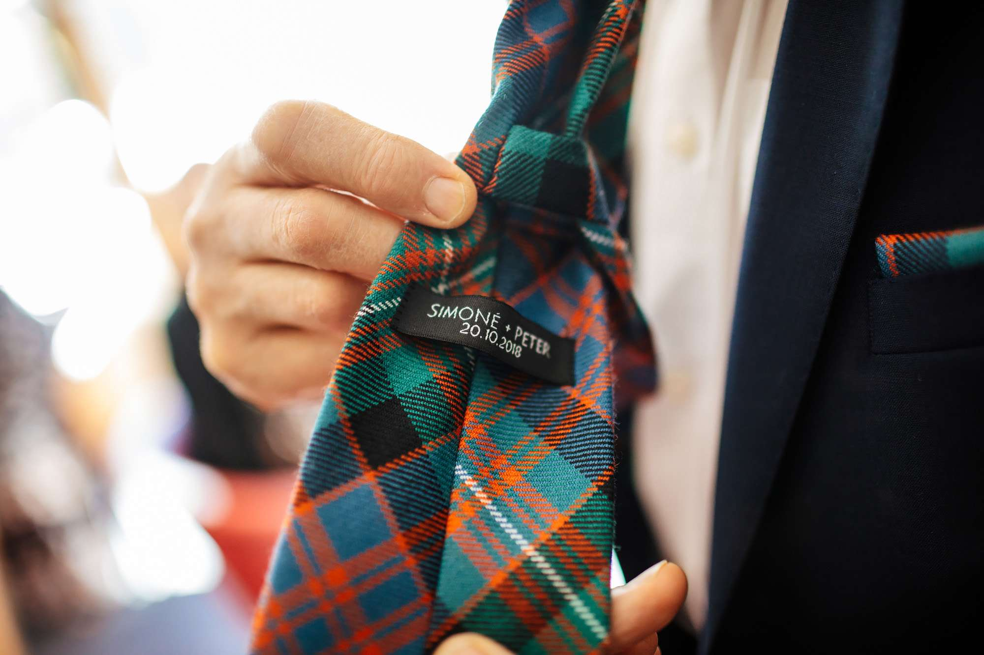 Groom has name and date embroidered on his tie