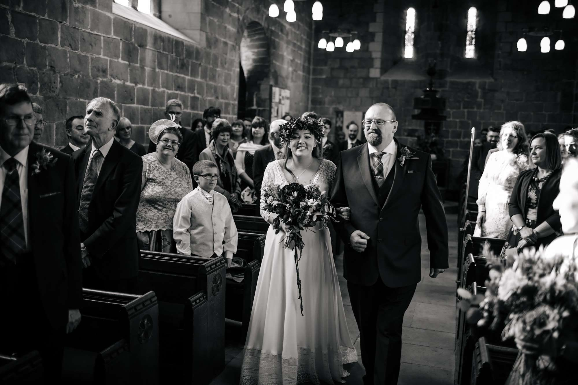 Bride and dad walk down the church aisle in Leeds