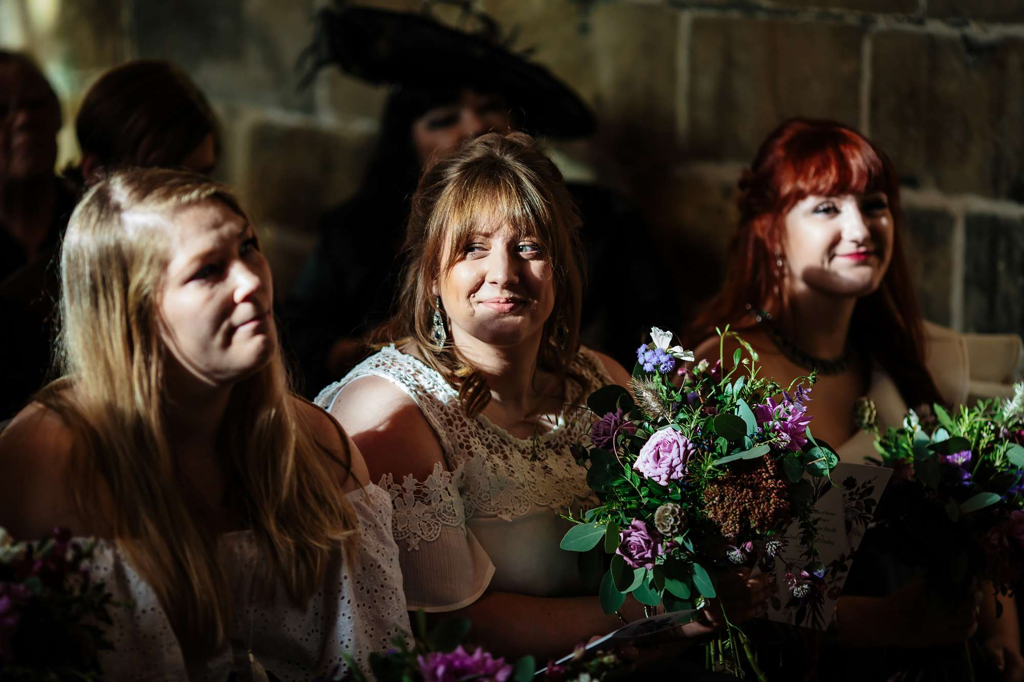 Bridesmaids smiling in the church at a wedding