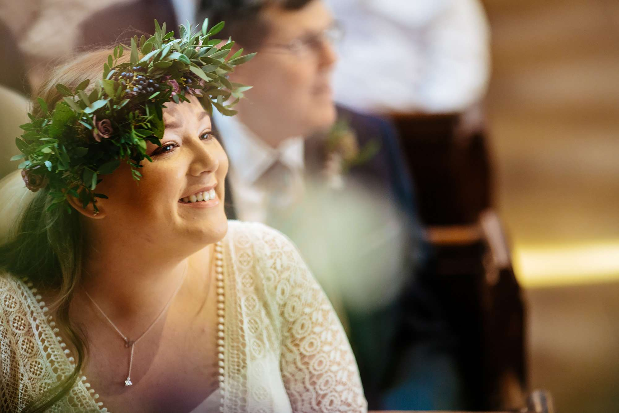Bride smiles during her church wedding ceremony