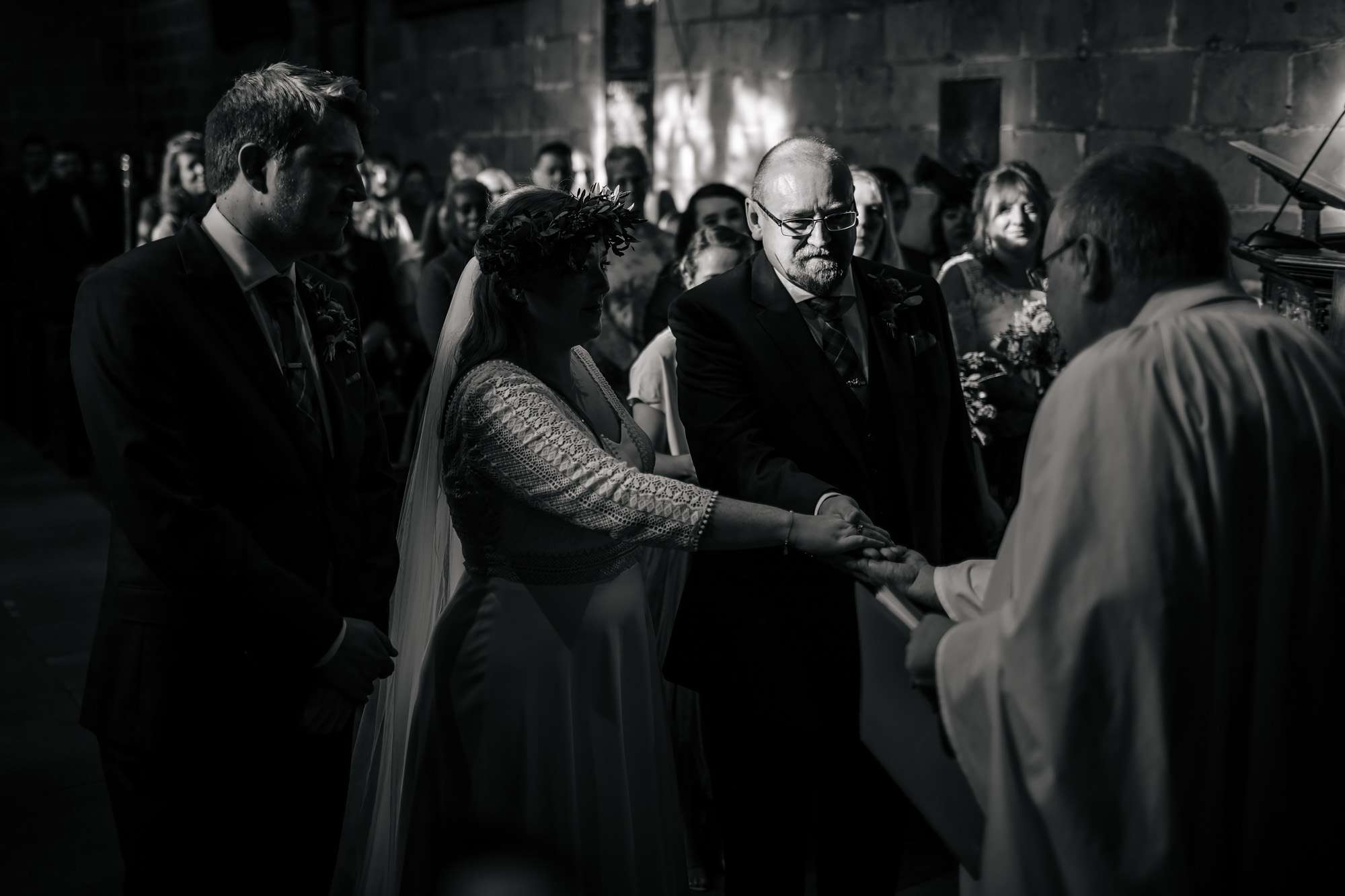 Bride and father holding hands on her wedding day