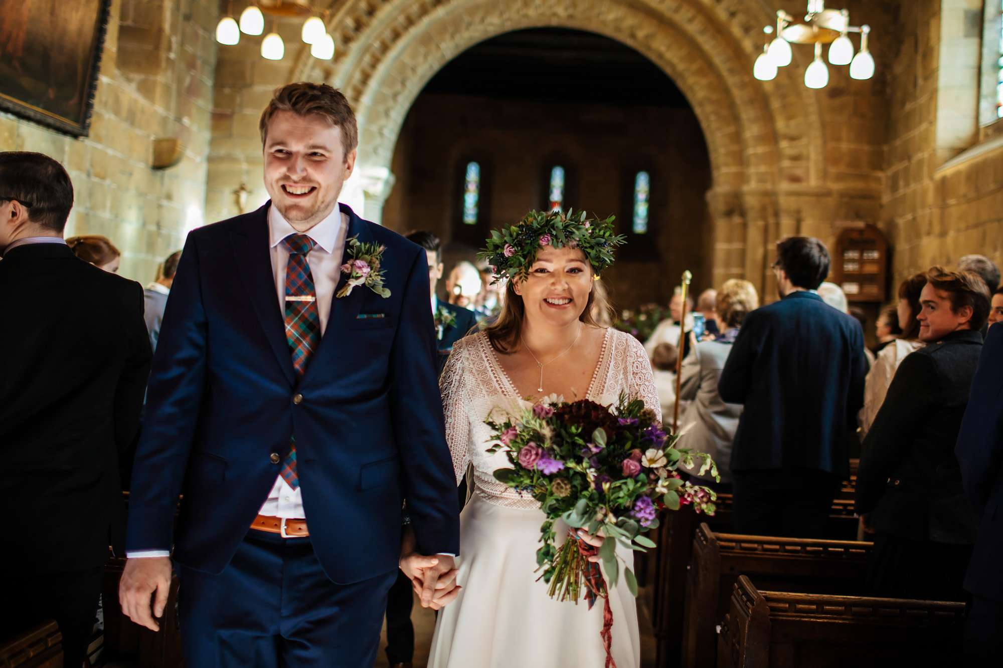 Bride and groom walking down the aisle in Leeds