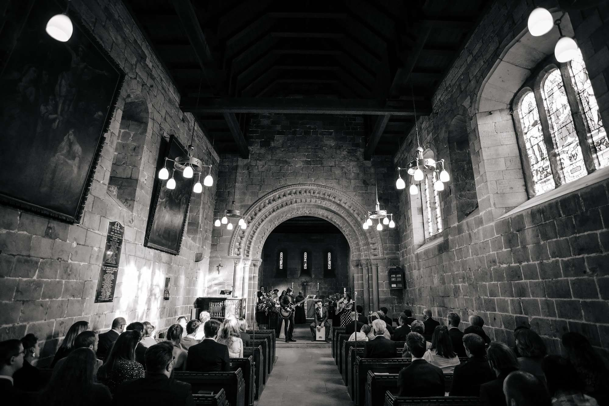 Black and white photo of a church wedding ceremony in Leeds