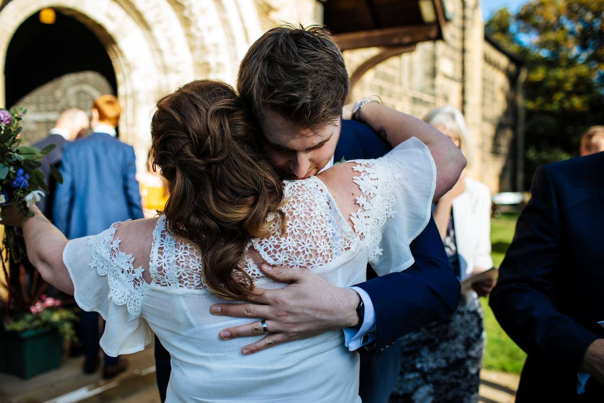 Wedding guests hugging in Leeds