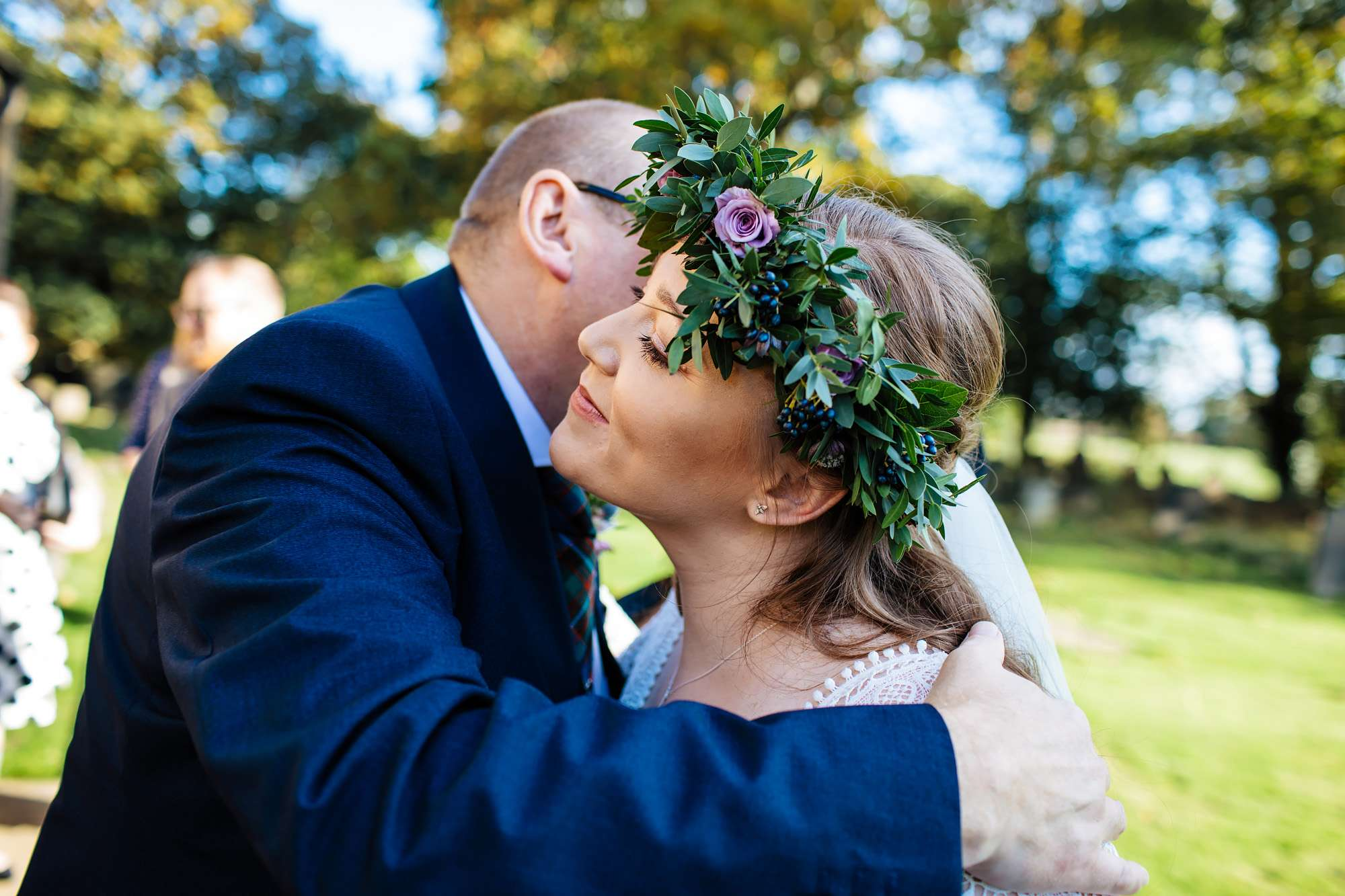 Bride kissing her father on her wedding day