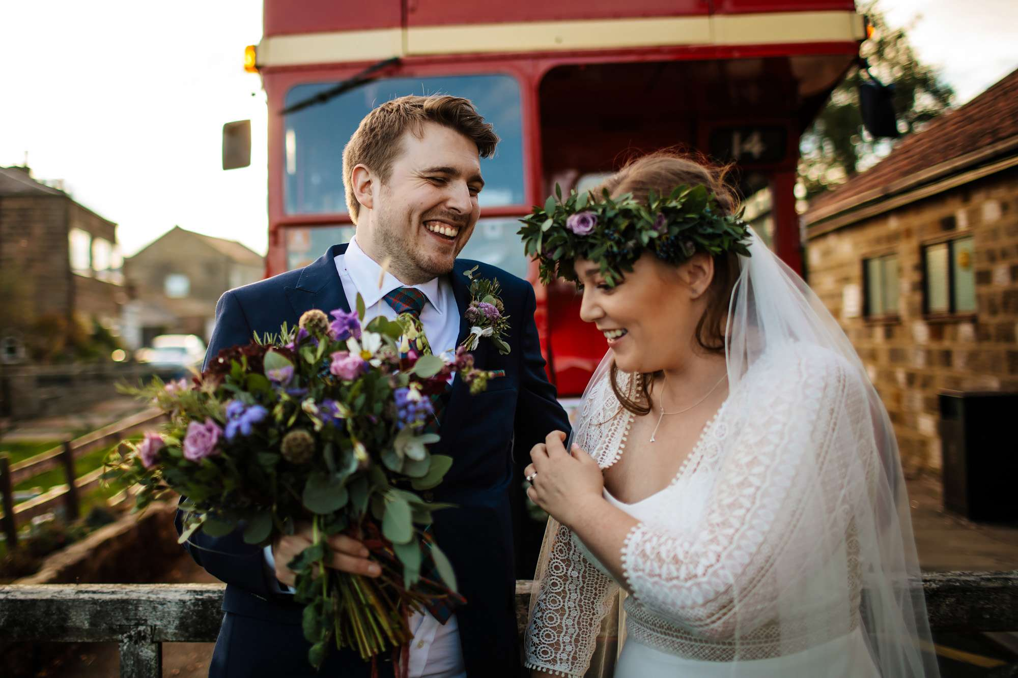 Bride and groom in front of their vintage wedding bus