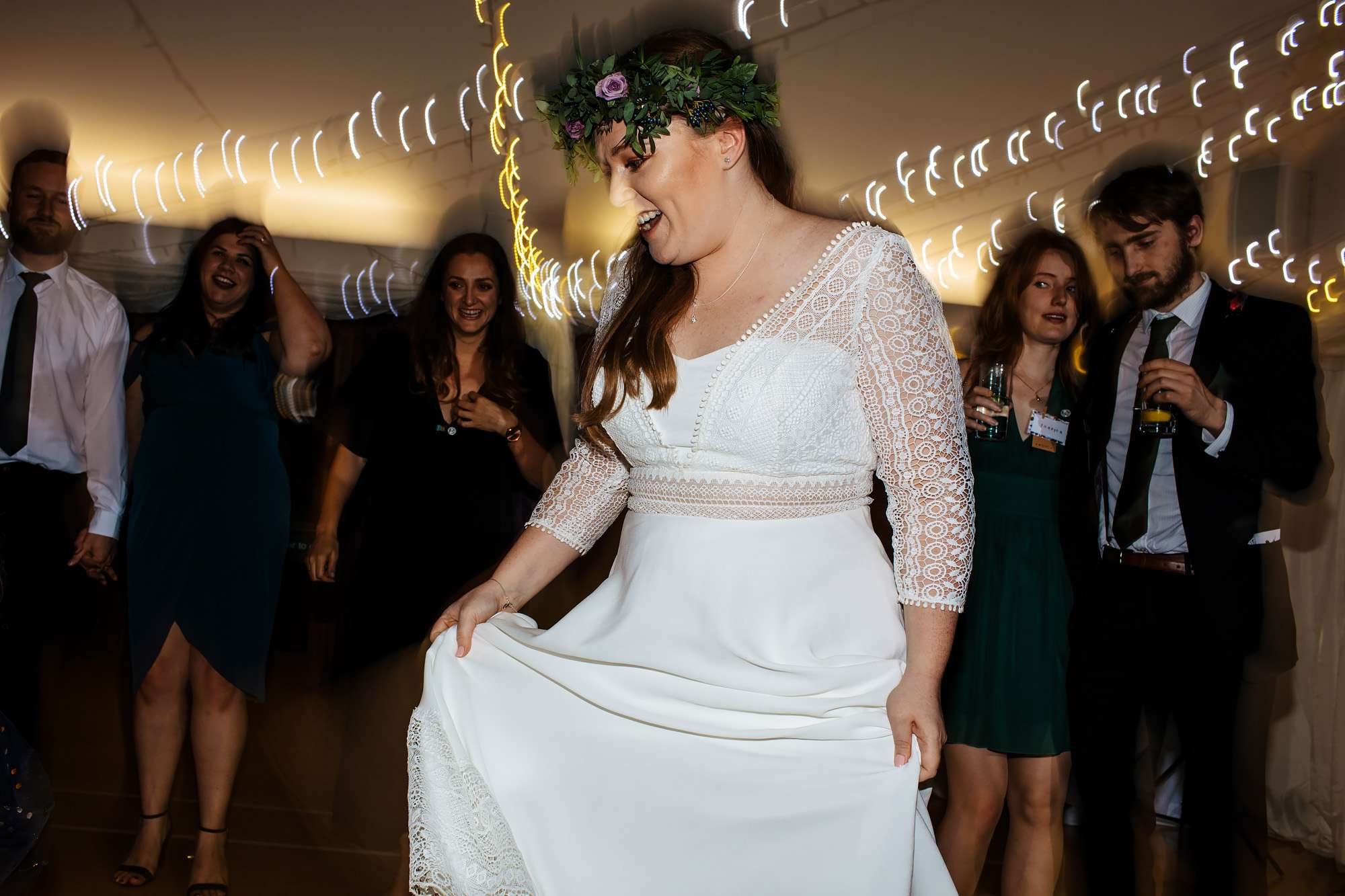 Bride on the dance floor at her wedding at East Keswick Village Hall