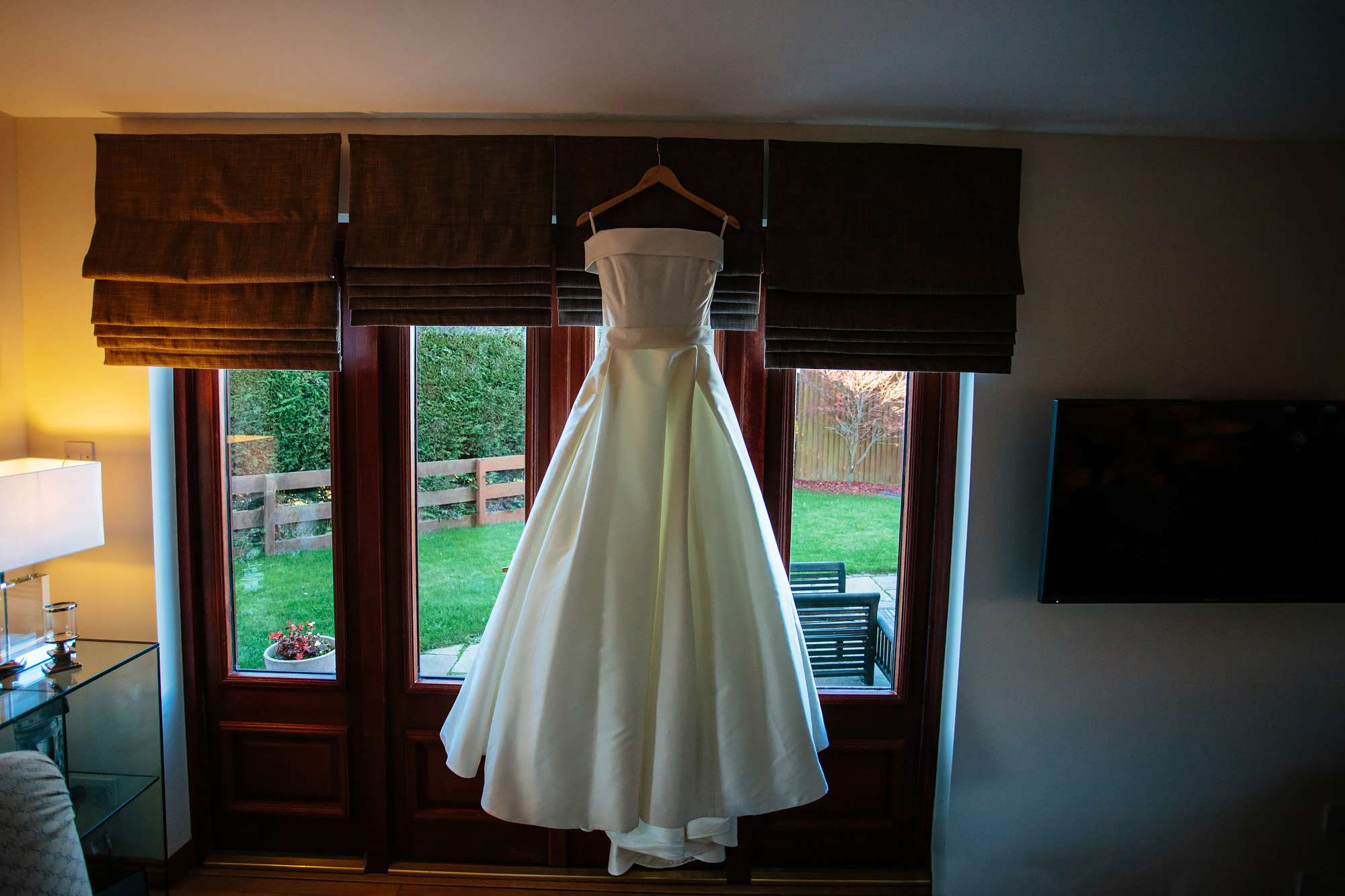Wedding dress hanging up in Fife