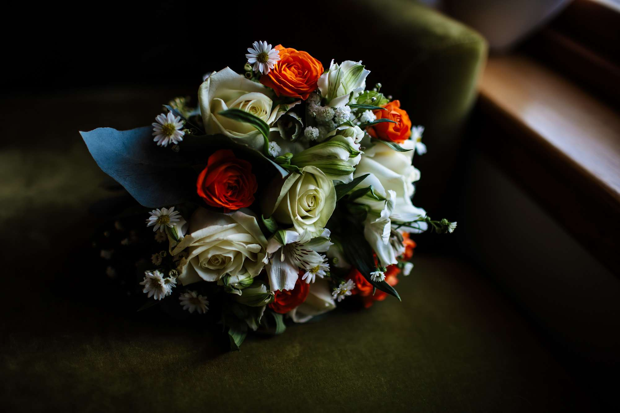 Bride's bouquet with orange and cream coloured flowers