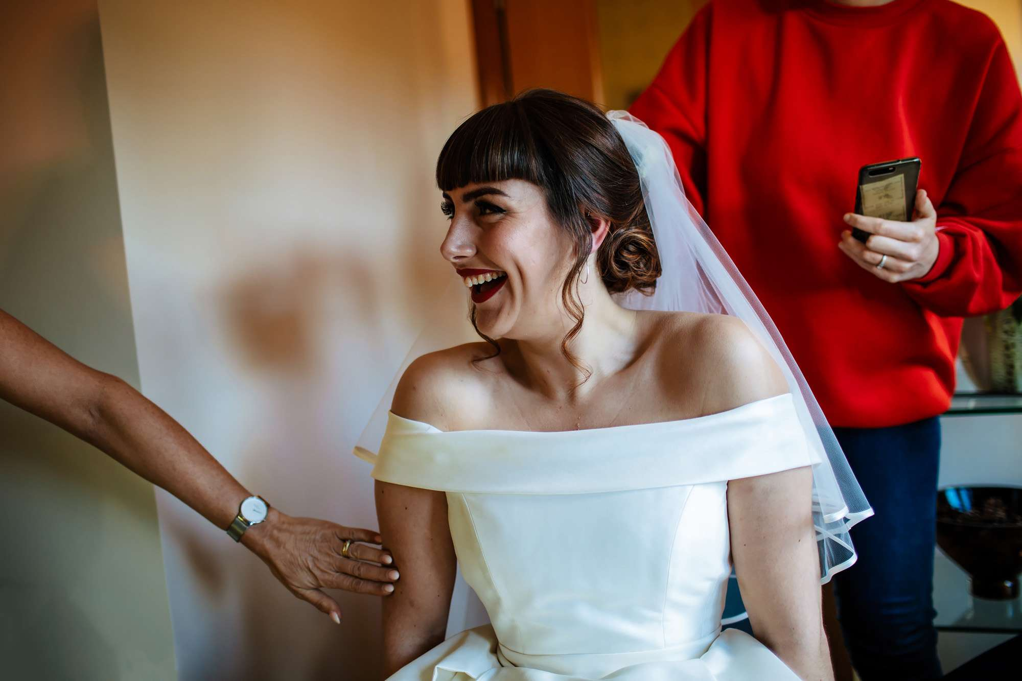 Bride laughing in her wedding dress in Fife