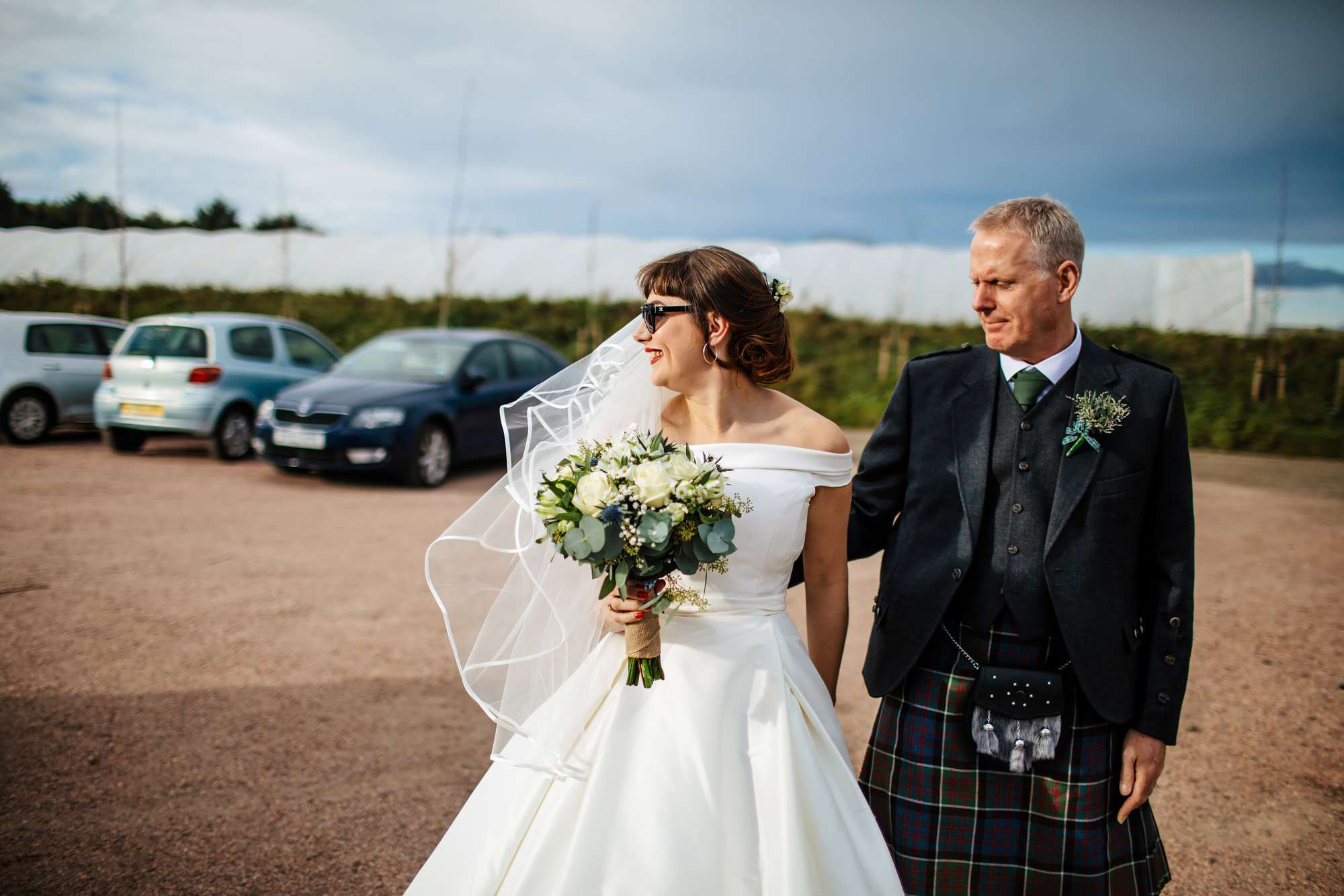 Bride and Dad walking to the wedding venue in Fife