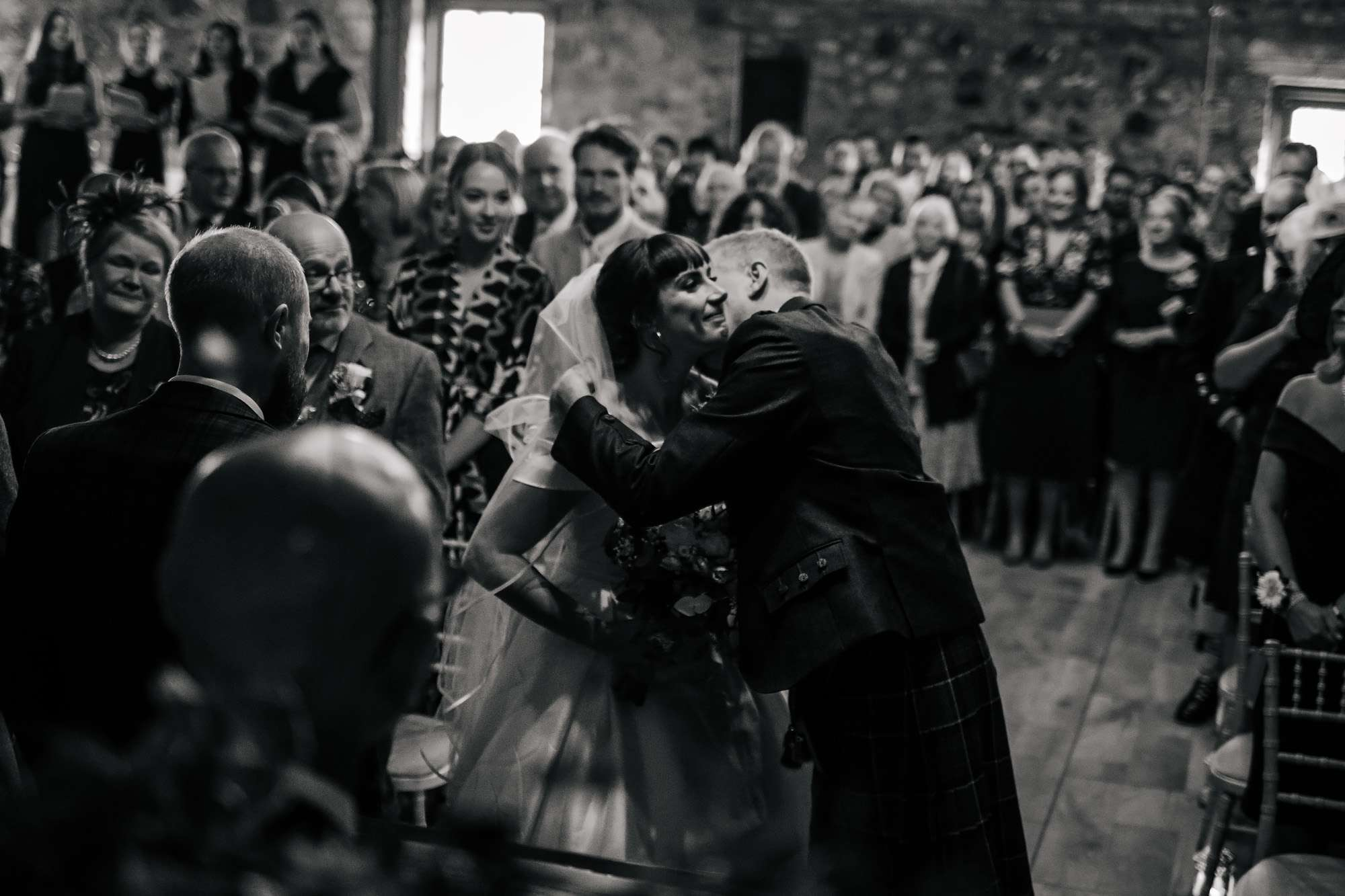 Bride and her father kiss at her wedding at The Rhynd Leuchars