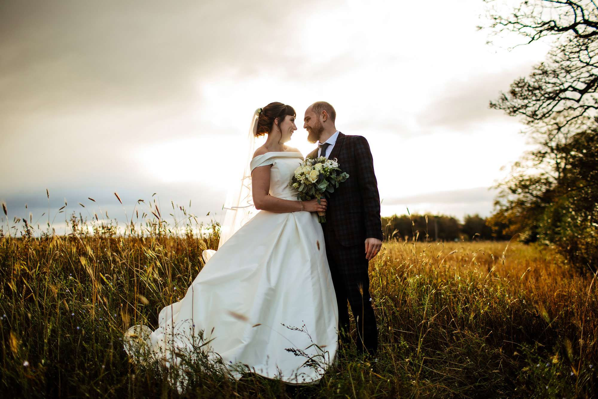 Couple portrait in a field at The Rhynd Leuchars wedding
