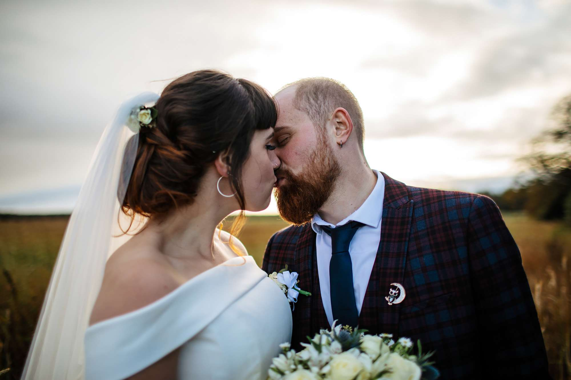 Bride and groom share a kiss at The Rhynd Leuchars