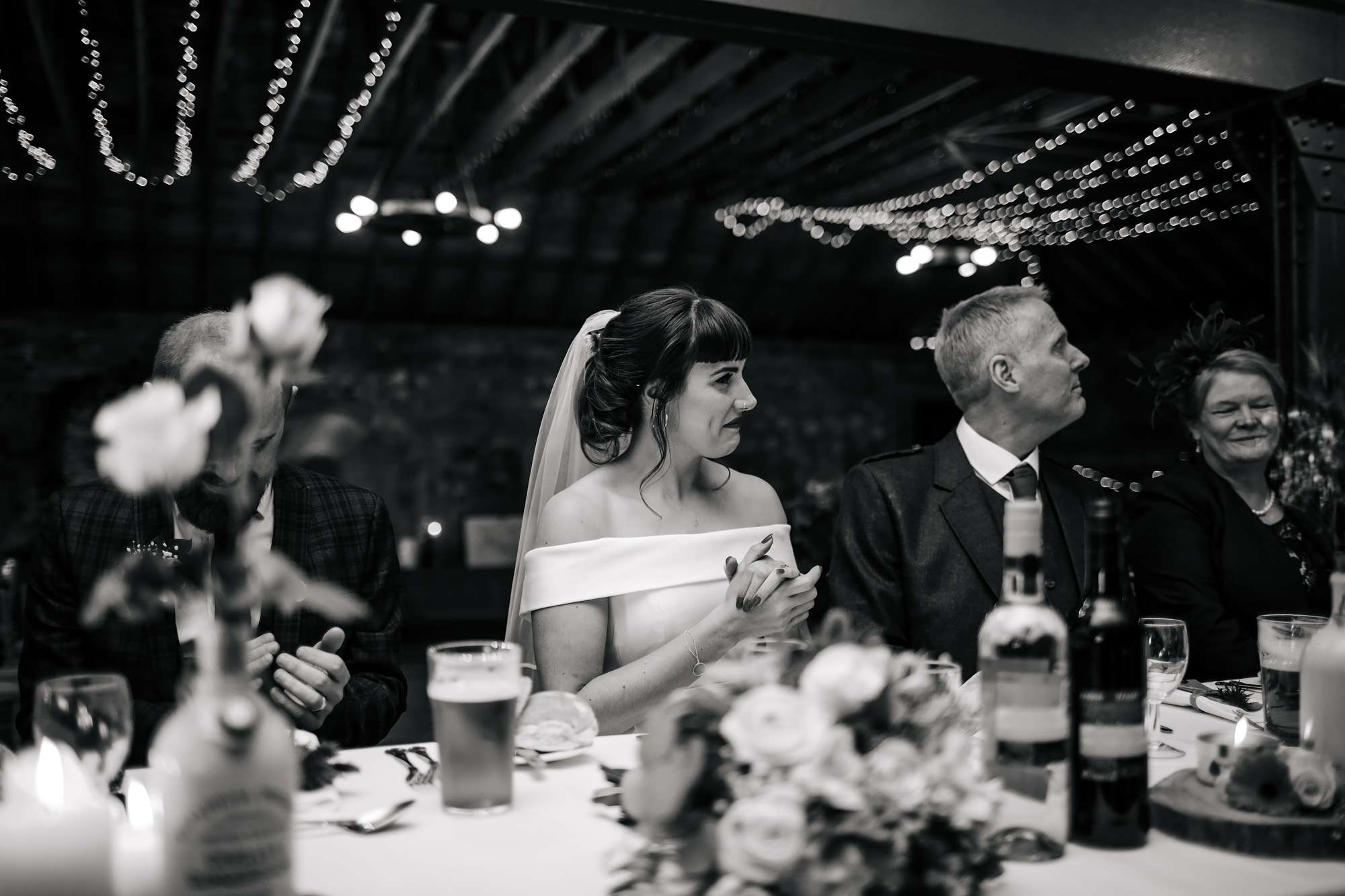 Bride clapping during the wedding speeches in Fife